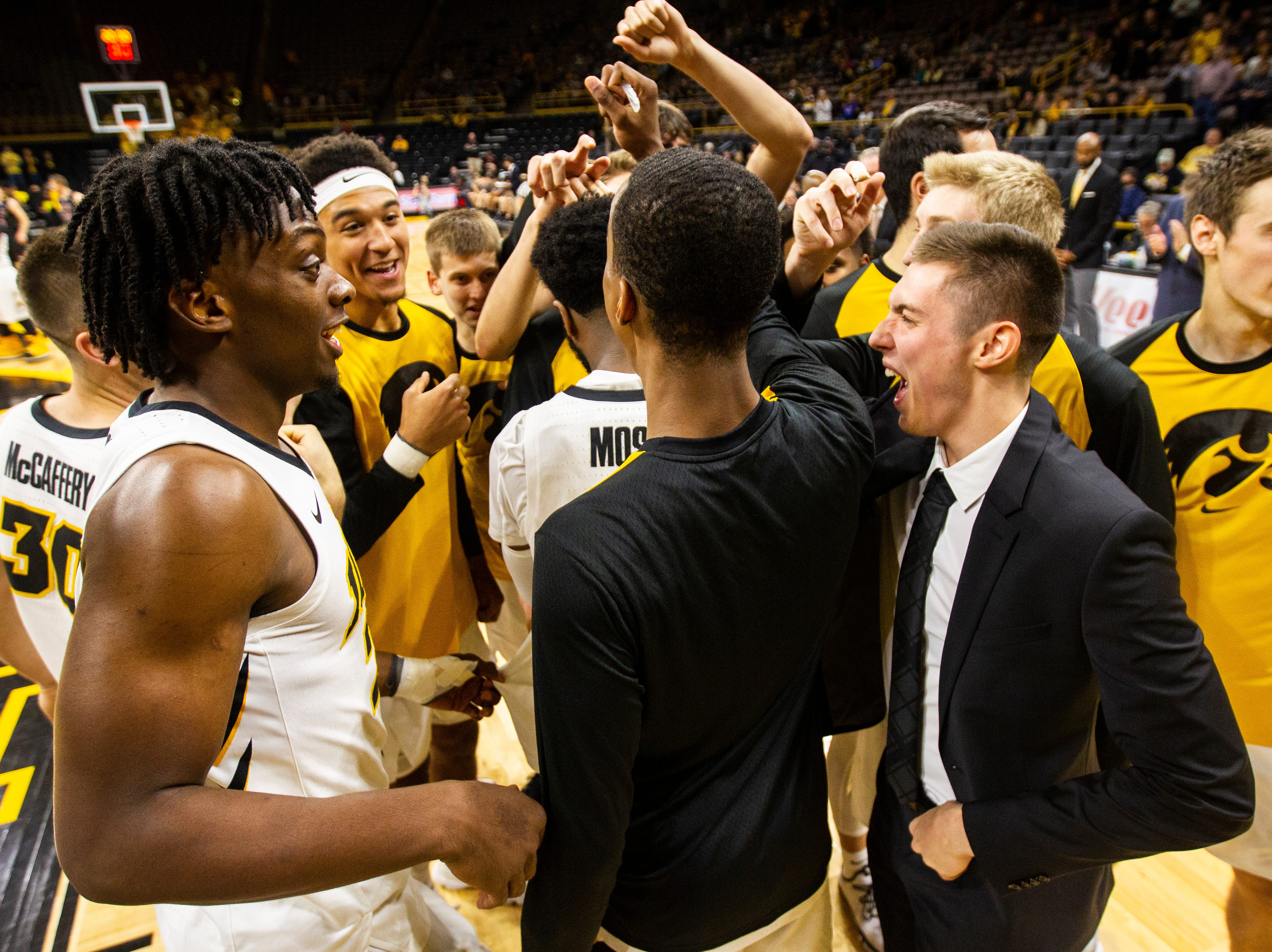 Iowa Hawkeyes players huddle together after introductions before a men's basketball exhibition game on Sunday, Nov. 4, 2018, at Carver-Hawkeye Arena in Iowa City.