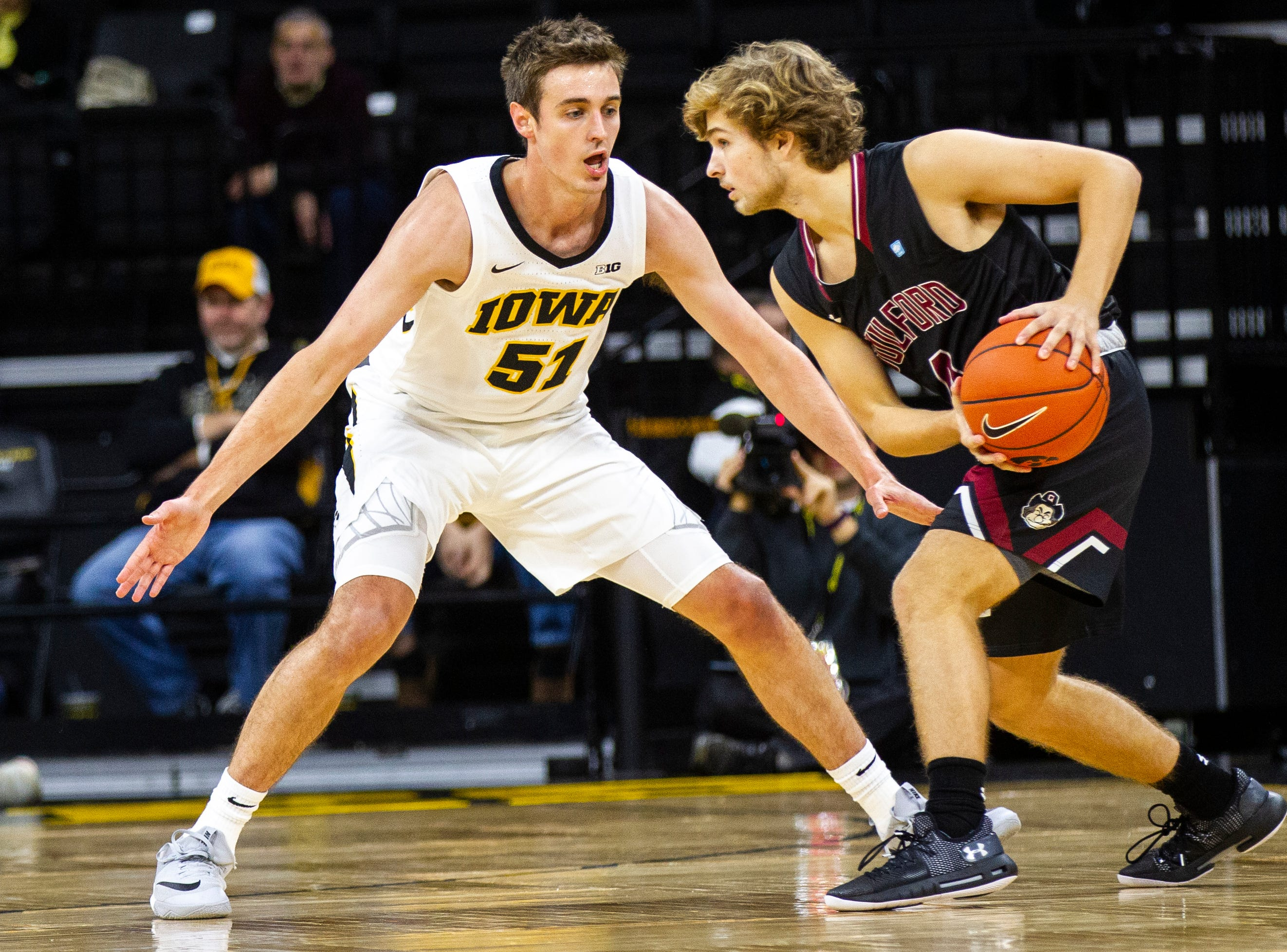 Iowa forward Nicholas Baer (51) defends Guildford's Luke Harkins (4) during a men's basketball exhibition game on Sunday, Nov. 4, 2018, at Carver-Hawkeye Arena in Iowa City.