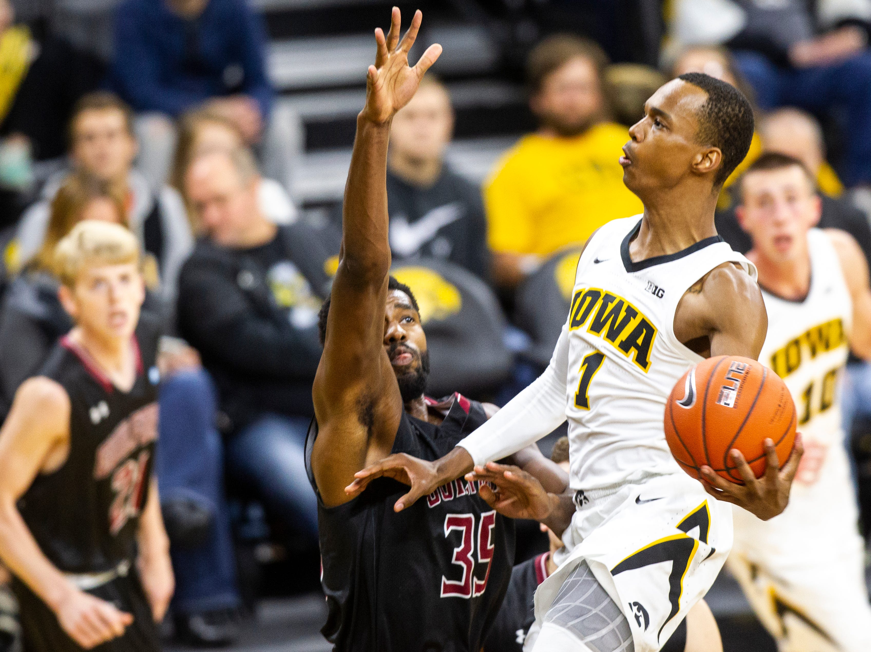 Iowa guard Maishe Dailey (1) goes for a layup during a men's basketball exhibition game on Sunday, Nov. 4, 2018, at Carver-Hawkeye Arena in Iowa City.
