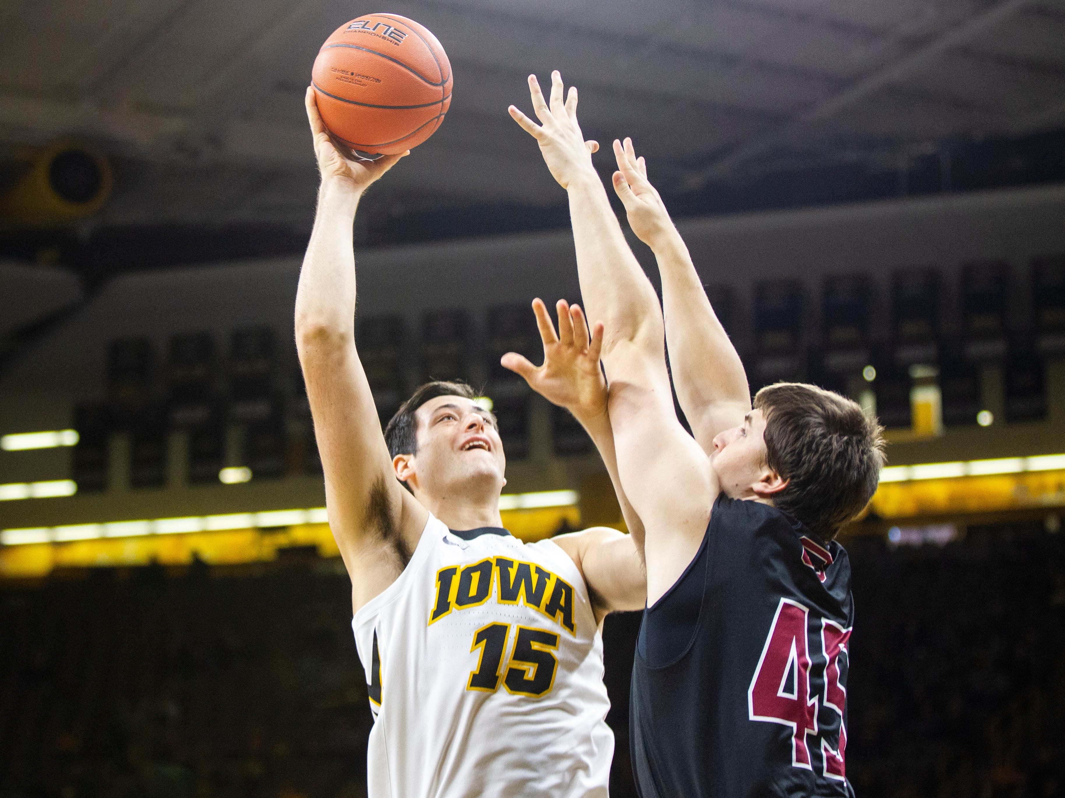 Iowa forward Ryan Kriener (15) shoots over Guilford's Steven Ruszala (45) during a men's basketball exhibition game on Sunday, Nov. 4, 2018, at Carver-Hawkeye Arena in Iowa City.