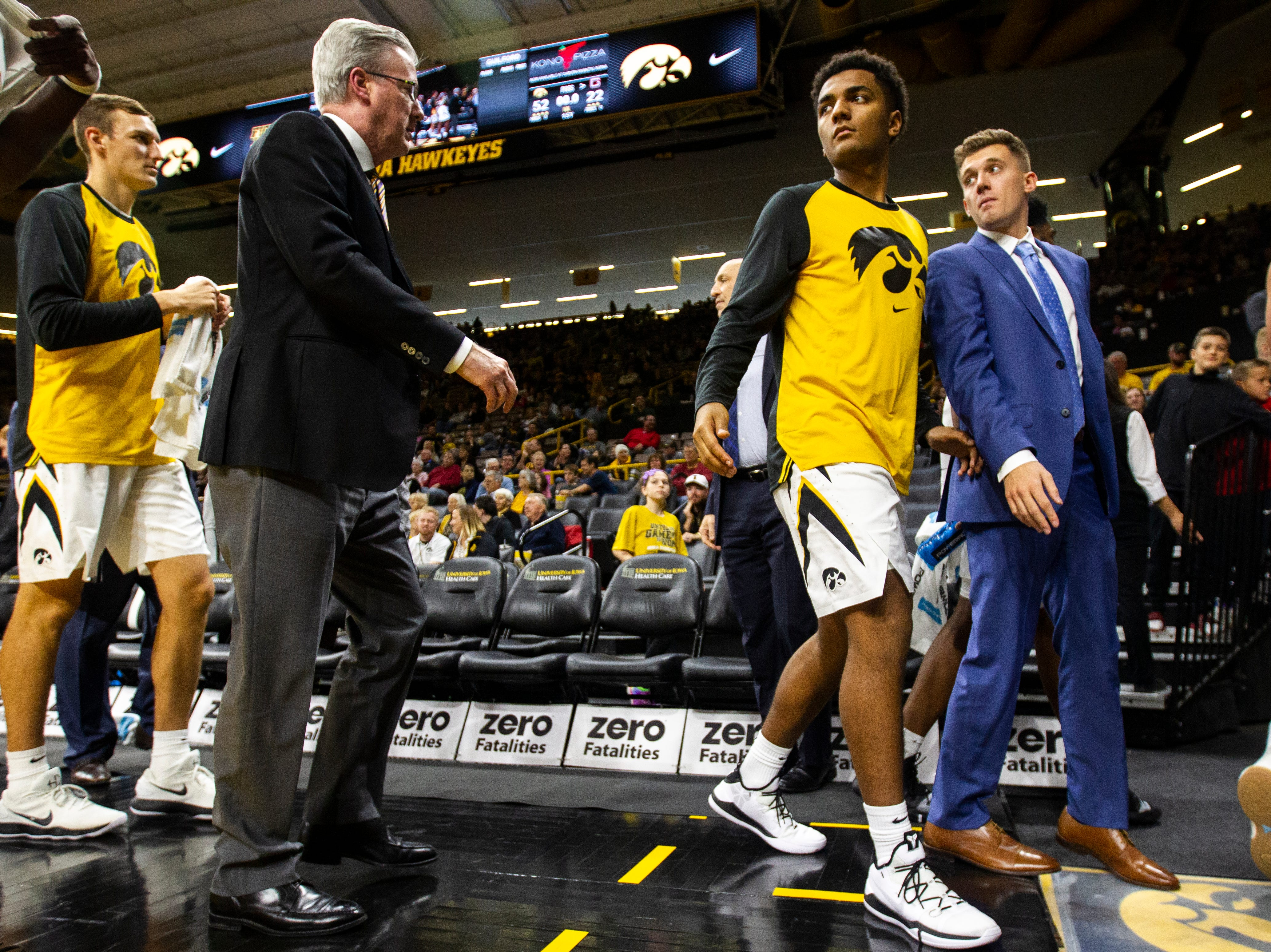 Iowa guard Jordan Bohannon (3) looks over his shoulder to Iowa men's basketball head coach Fran McCaffery at the half during a men's basketball exhibition game on Sunday, Nov. 4, 2018, at Carver-Hawkeye Arena in Iowa City.