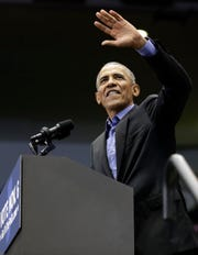 Former President Barack Obama waves to Democratic supporters at Genesis Convention Center, Sunday, Nov. 4, 2018, in Gary, Ind. Obama rallied Democrats on behalf of Sen. Joe Donnelly, D-Ind., who faces a stiff challenge from Republican businessman Mike Braun. (AP Photo/Nam Y. Huh)
