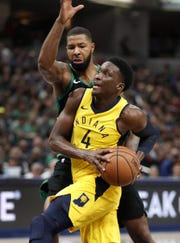 Indiana Pacers guard Victor Oladipo (4) drives on Boston Celtics forward Marcus Morris (13) in the second half of their game at Bankers Life Fieldhouse on Nov 3, 2018.