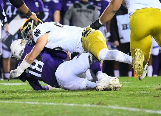Notre Dame Fighting Irish linebacker Drue Tranquill (23) sacks Northwestern Wildcats quarterback Clayton Thorson (18) during the first quarter at Ryan Field.