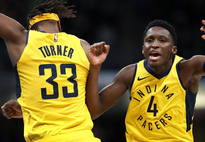 Indiana Pacers guard Victor Oladipo (4) celebrates with Myles Turner, left, following their 102-101 victory over the Boston Celtics following their game at Bankers Life Fieldhouse on Nov 3, 2018.