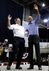 Former President Barack Obama, right, and Democratic gubernatorial candidate U.S. Sen. Joe Donnelly smile as they wave to the crowd during a campaign rally at Genesis Convention Center in Gary, Ind., Sunday, Nov. 4, 2018. (AP Photo/Nam Y. Huh)