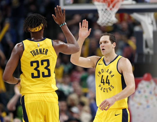 Indiana Pacers forward Bojan Bogdanovic (44) high-fives  Myles Turner (33) in the second half of their game at Bankers Life Fieldhouse on Nov 3, 2018.