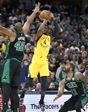 Indiana Pacers guard Victor Oladipo (4) shoots the game-winning three pointer over Boston Celtics center Al Horford (42) late in the fourth quarter of their game at Bankers Life Fieldhouse on Nov 3, 2018.