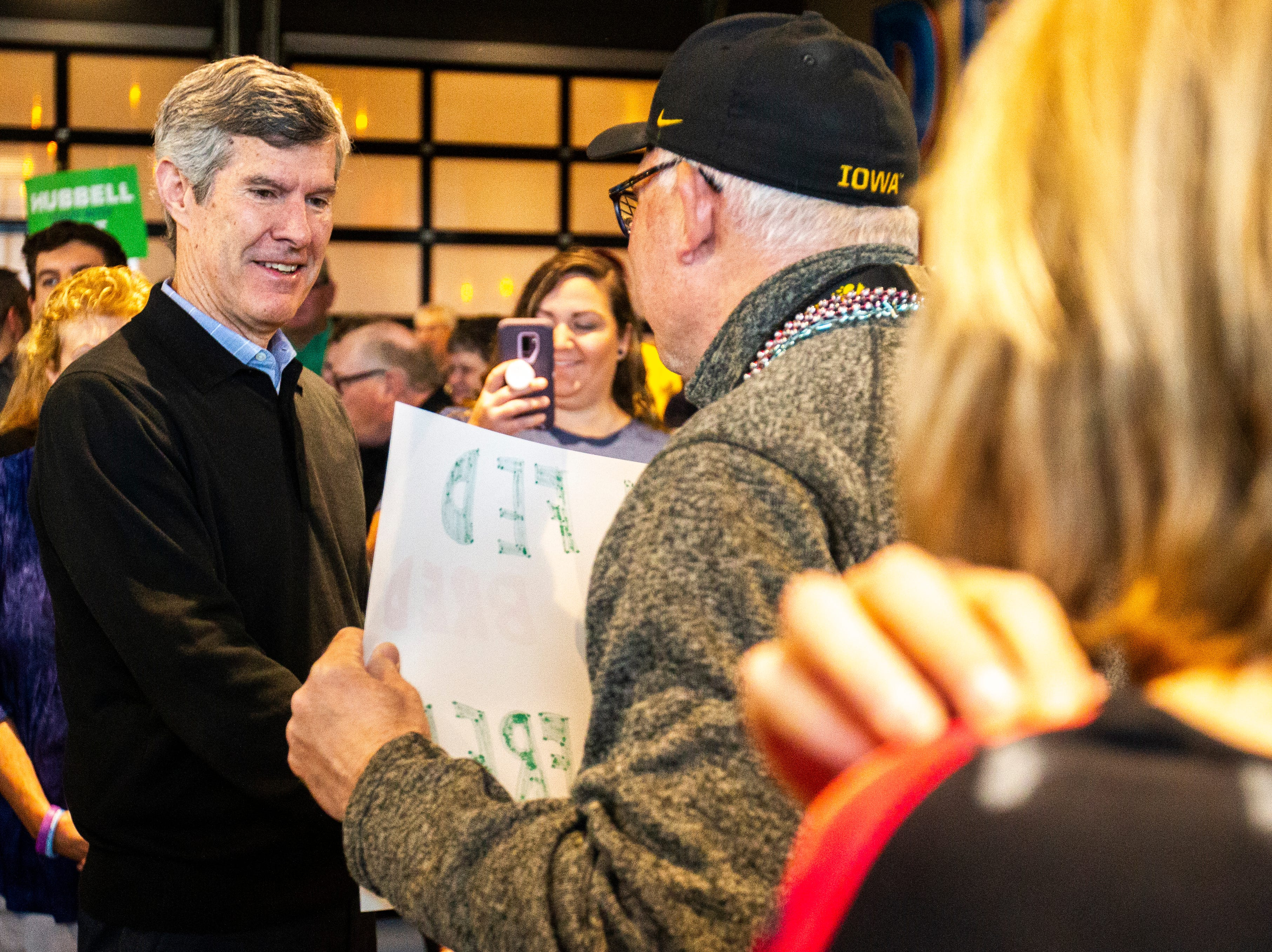 Fred Hubbell, Iowa Democratic candidate for governor, shakes hands with supporters during a rally on Sunday, Nov. 4, 2018, at Big Grove Brewery in Iowa City.
