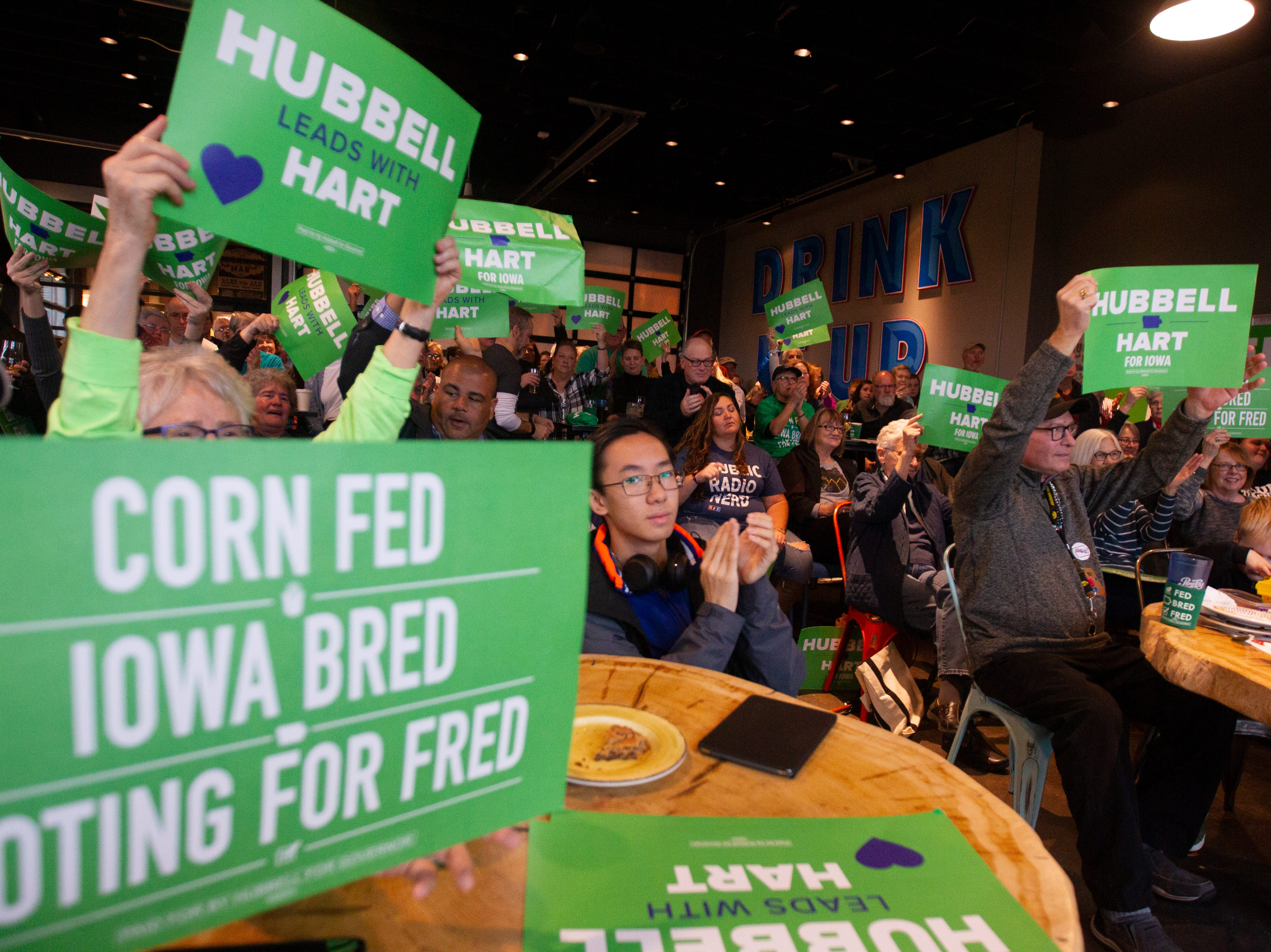 Supporters cheer as Fred Hubbell, Iowa Democratic candidate for governor, speaks during a rally on Sunday, Nov. 4, 2018, at Big Grove Brewery in Iowa City.