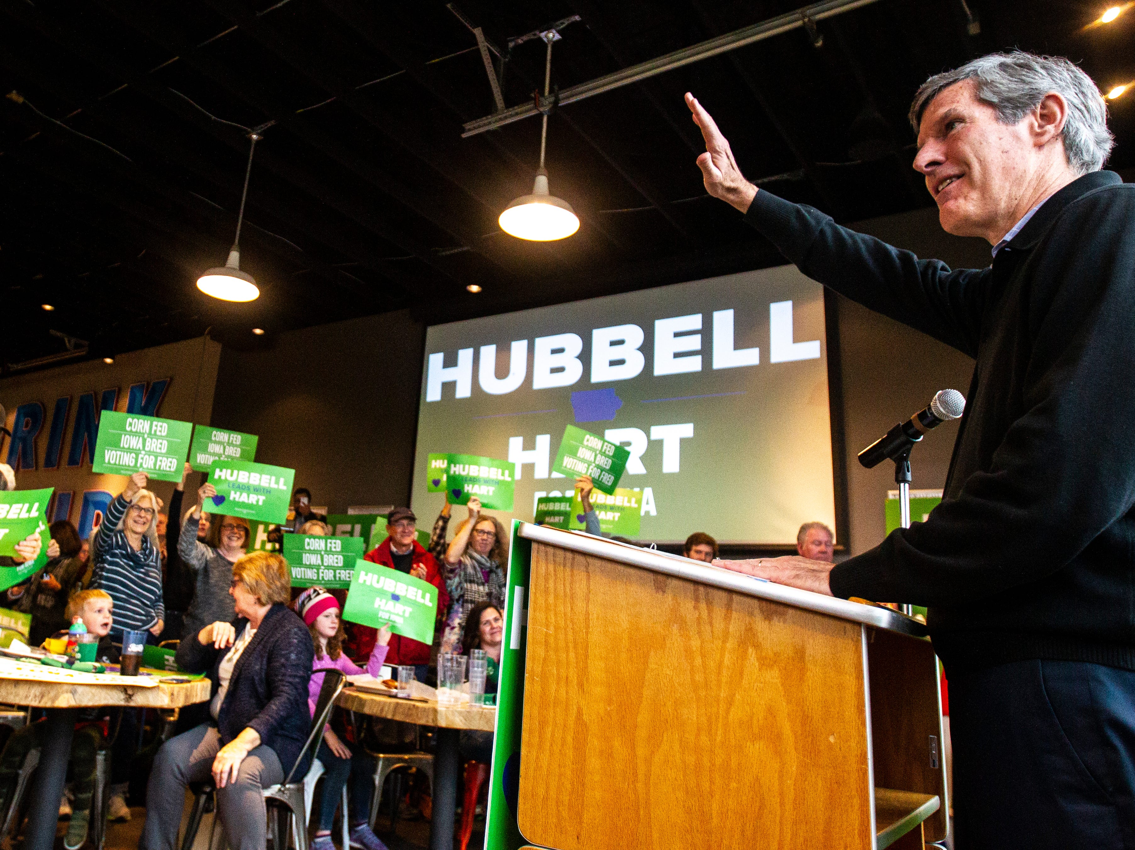 Fred Hubbell, Iowa Democratic candidate for governor, waves to supporters during a rally on Sunday, Nov. 4, 2018, at Big Grove Brewery in Iowa City.