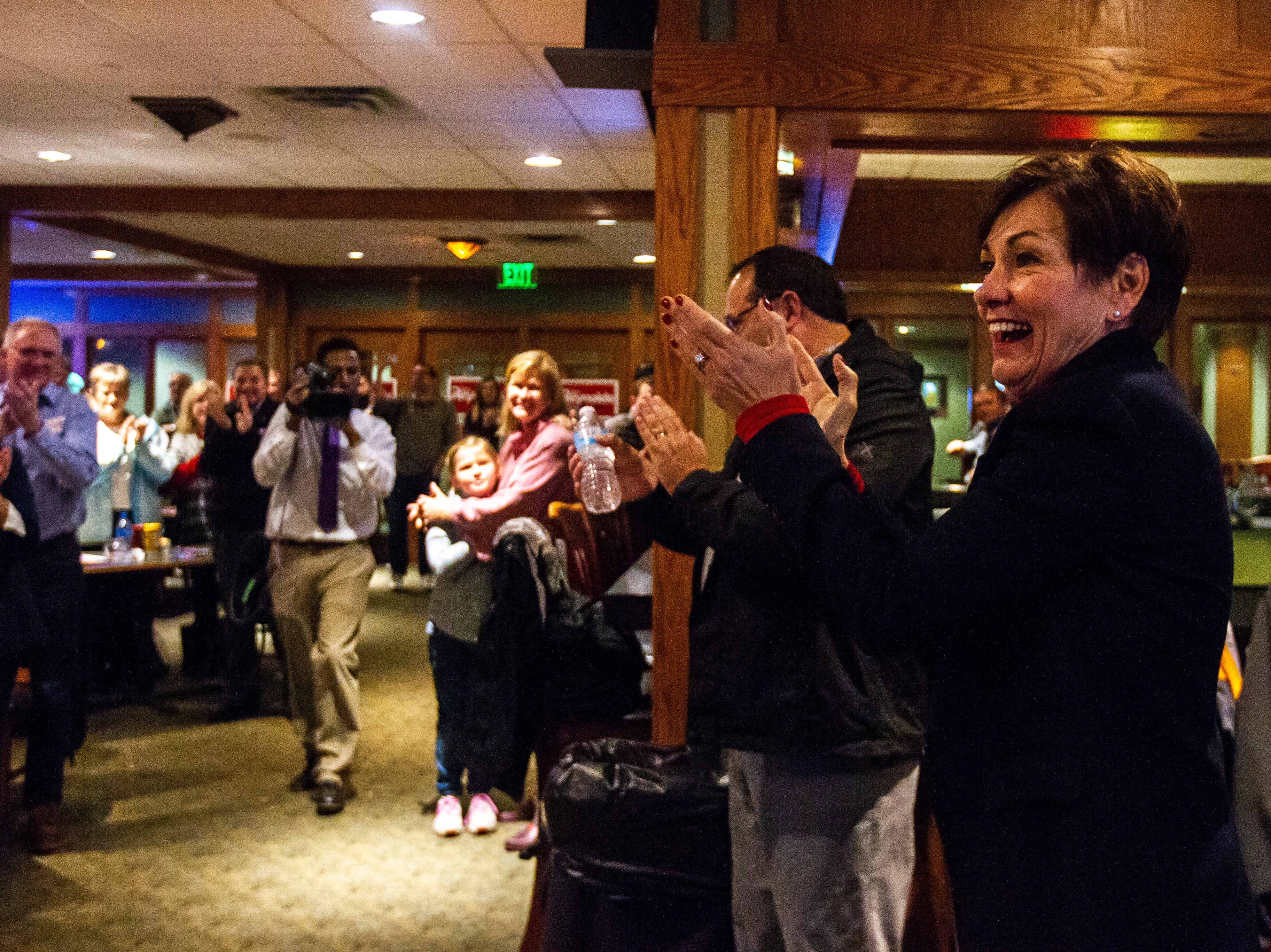 Iowa Gov. Kim Reynolds is welcomed by supporters on Sunday, Nov. 4, 2018, at Brown Deer Golf Club in Coralville, Iowa.