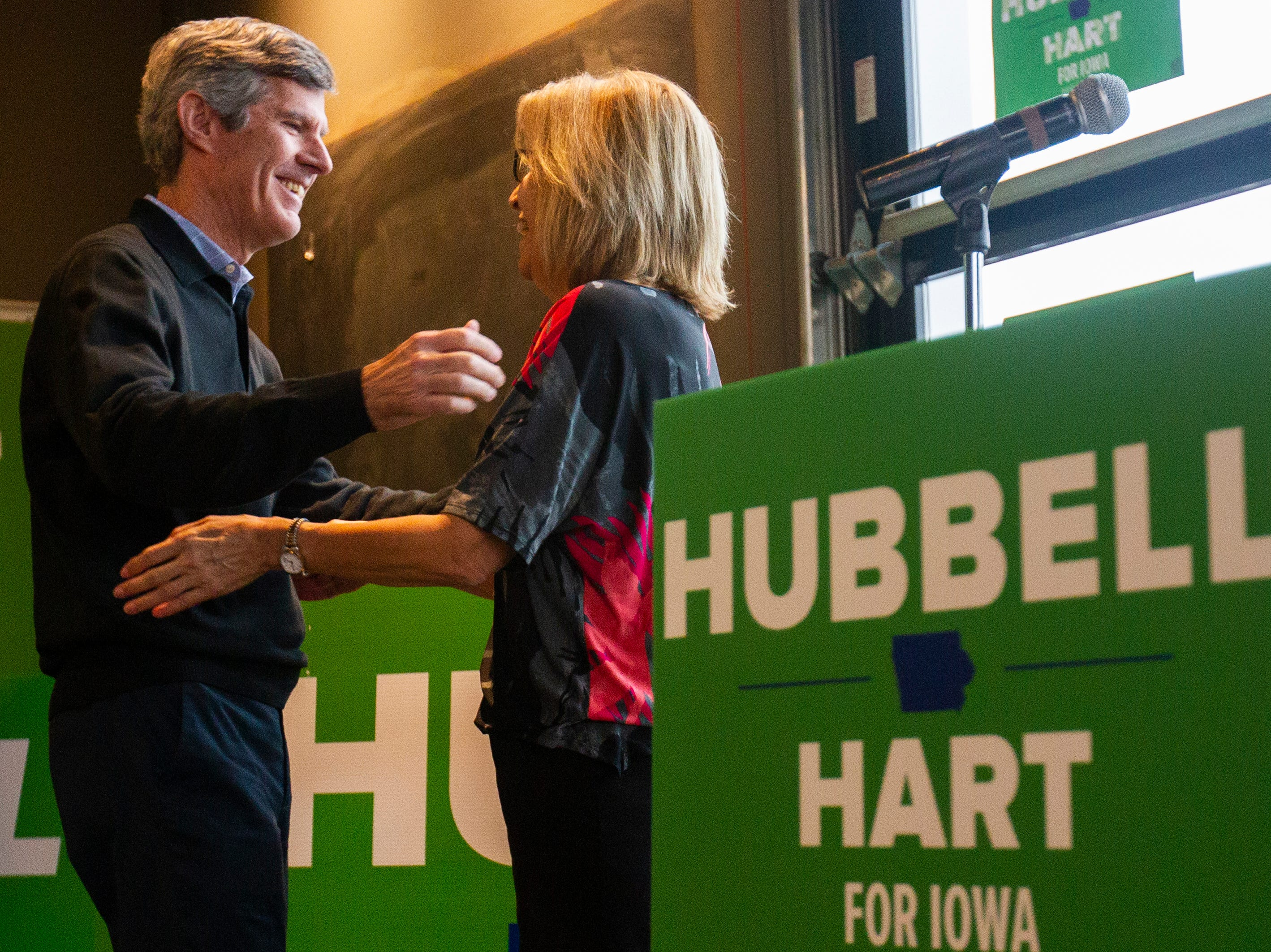 Fred Hubbell, Iowa Democratic candidate for governor, embraces his running mate Rita Hart before he speaks during a rally on Sunday, Nov. 4, 2018, at Big Grove Brewery in Iowa City.