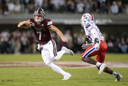 Mississippi State's Nick Fitzgerald (7) tries to evade Louisiana's Ja'len Johnson (28) in the first half. Mississippi State and Louisiana Tech played in a college football game on Saturday, November 3, 2018, in Starkville. Photo by Keith Warren/Madatory Photo Credit