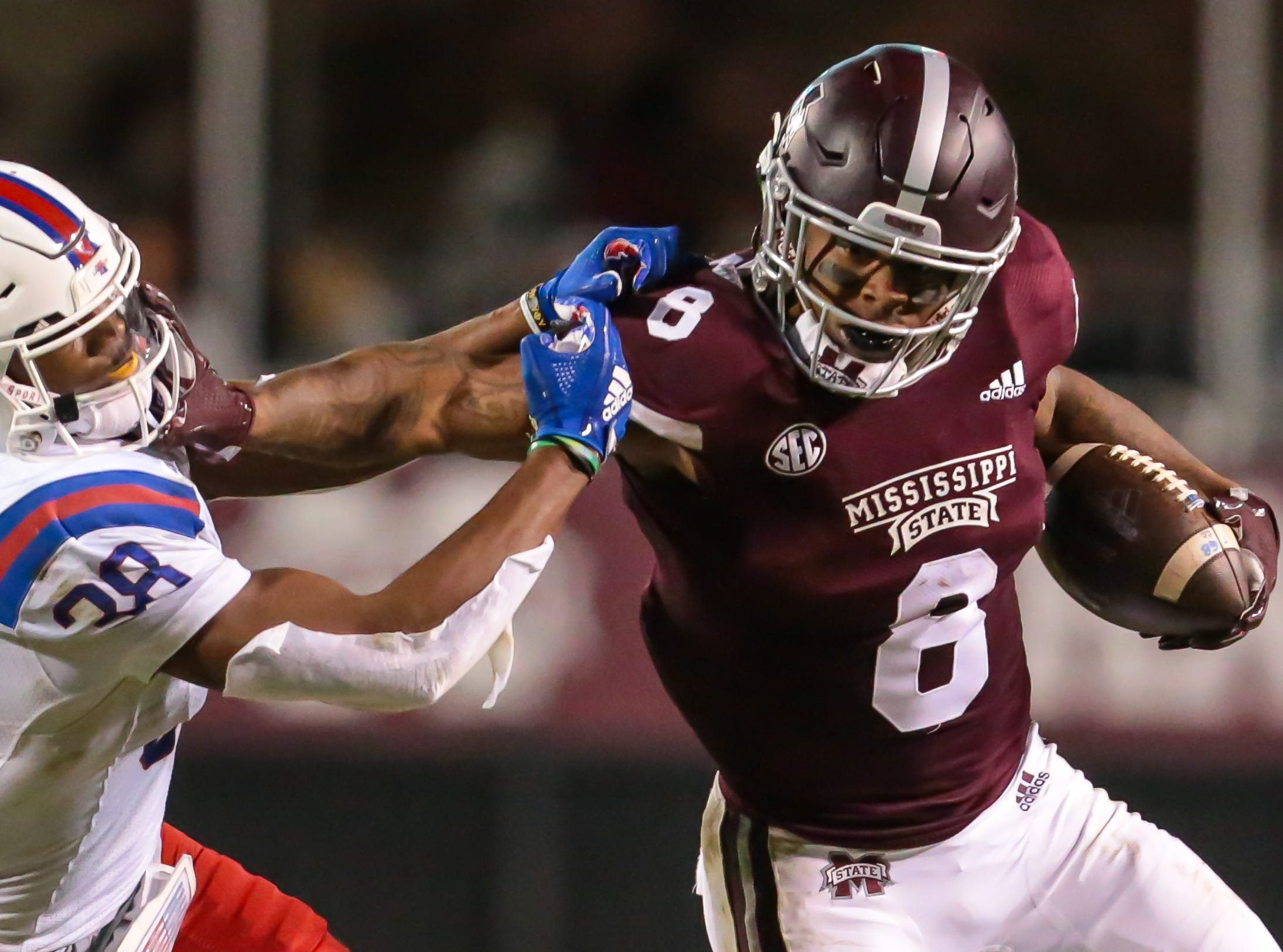 Mississippi State's Kylin Hill (8) tries to break away from Louisiana Tech's Terik Miller (38) in the second quarter. Mississippi State and Louisiana Tech played in a college football game on Saturday, November 3, 2018, in Starkville. Photo by Keith Warren/Madatory Photo Credit