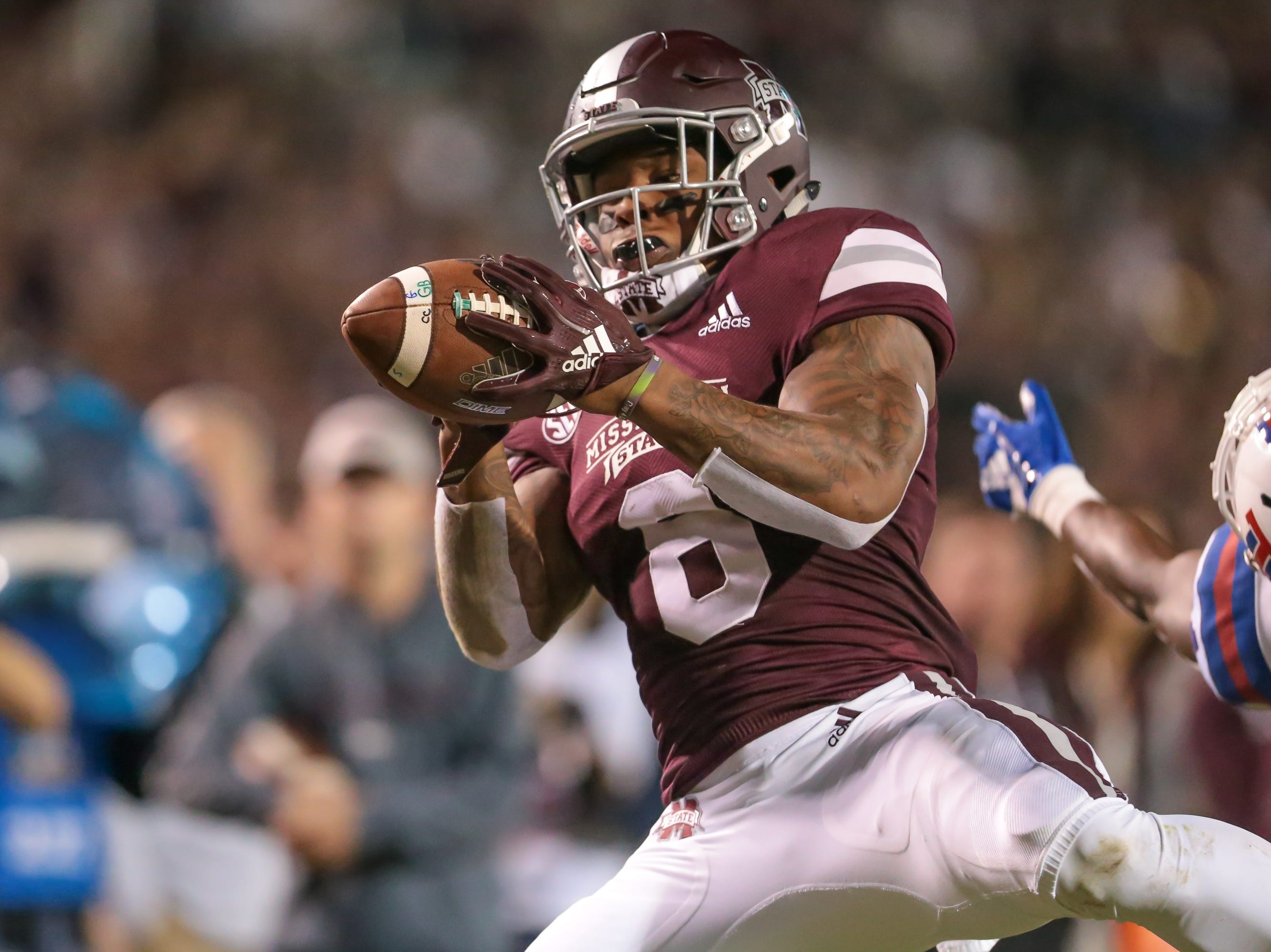 Mississippi State's Kylin Hill (8) catches a touchdown pass in the first half. Mississippi State and Louisiana Tech played in a college football game on Saturday, November 3, 2018, in Starkville. Photo by Keith Warren/Madatory Photo Credit