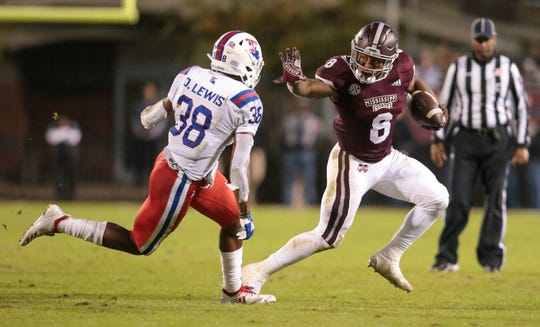 Mississippi State's Kylin Hill (8) tries to make a move on Louisiana's Terik Miller (38) in the second quarter. Mississippi State and Louisiana Tech played in a college football game on Saturday, November 3, 2018, in Starkville. Photo by Keith Warren/Madatory Photo Credit