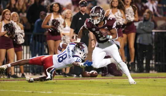 Mississippi State's Deddrick Thomas (2) avoids Louisiana's Asjlin Washington (18) on a touchdown run in the first quarter. Mississippi State and Louisiana Tech played in a college football game on Saturday, November 3, 2018, in Starkville. Photo by Keith Warren/Madatory Photo Credit