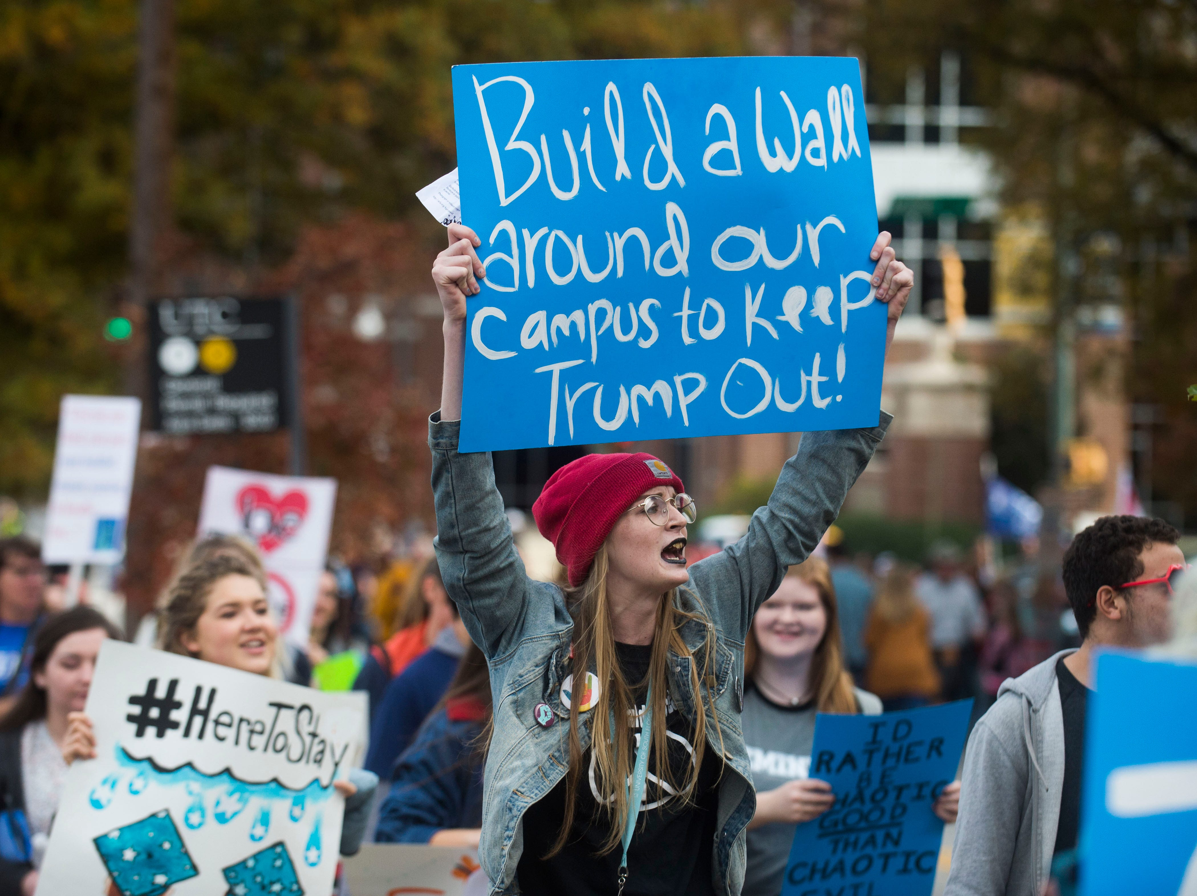 University of Tennessee Chattanooga students march towards a protest before a Donald Trump rally in support of U.S. Rep. Marsha Blackburn for the U.S. Senate at McKenzie Arena in Chattanooga, Sunday, Nov. 4, 2018.