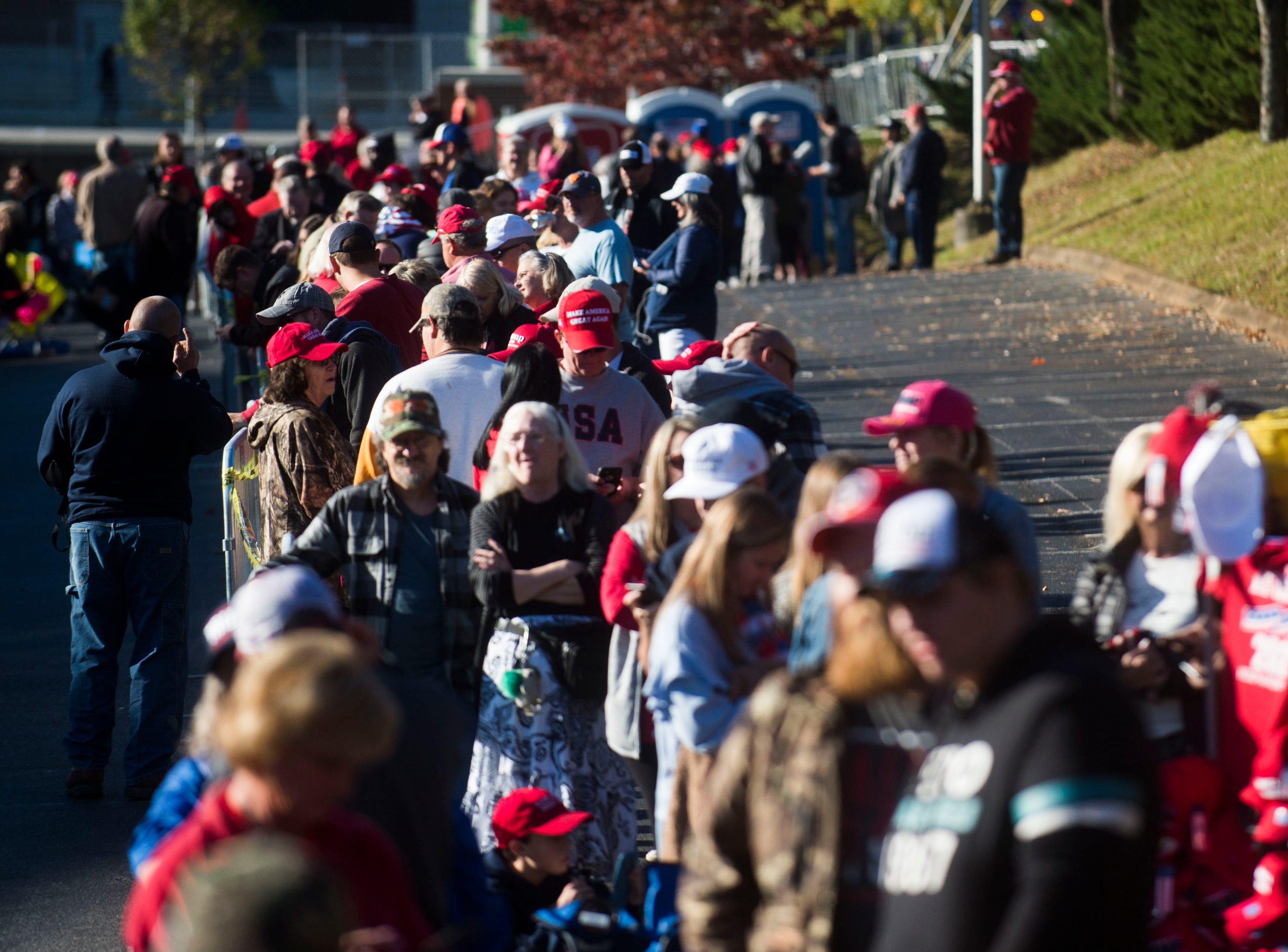 Trump supporters wait in line before a Donald Trump rally in support of U.S. Rep. Marsha Blackburn for the U.S. Senate at McKenzie Arena in Chattanooga, Sunday, Nov. 4, 2018.