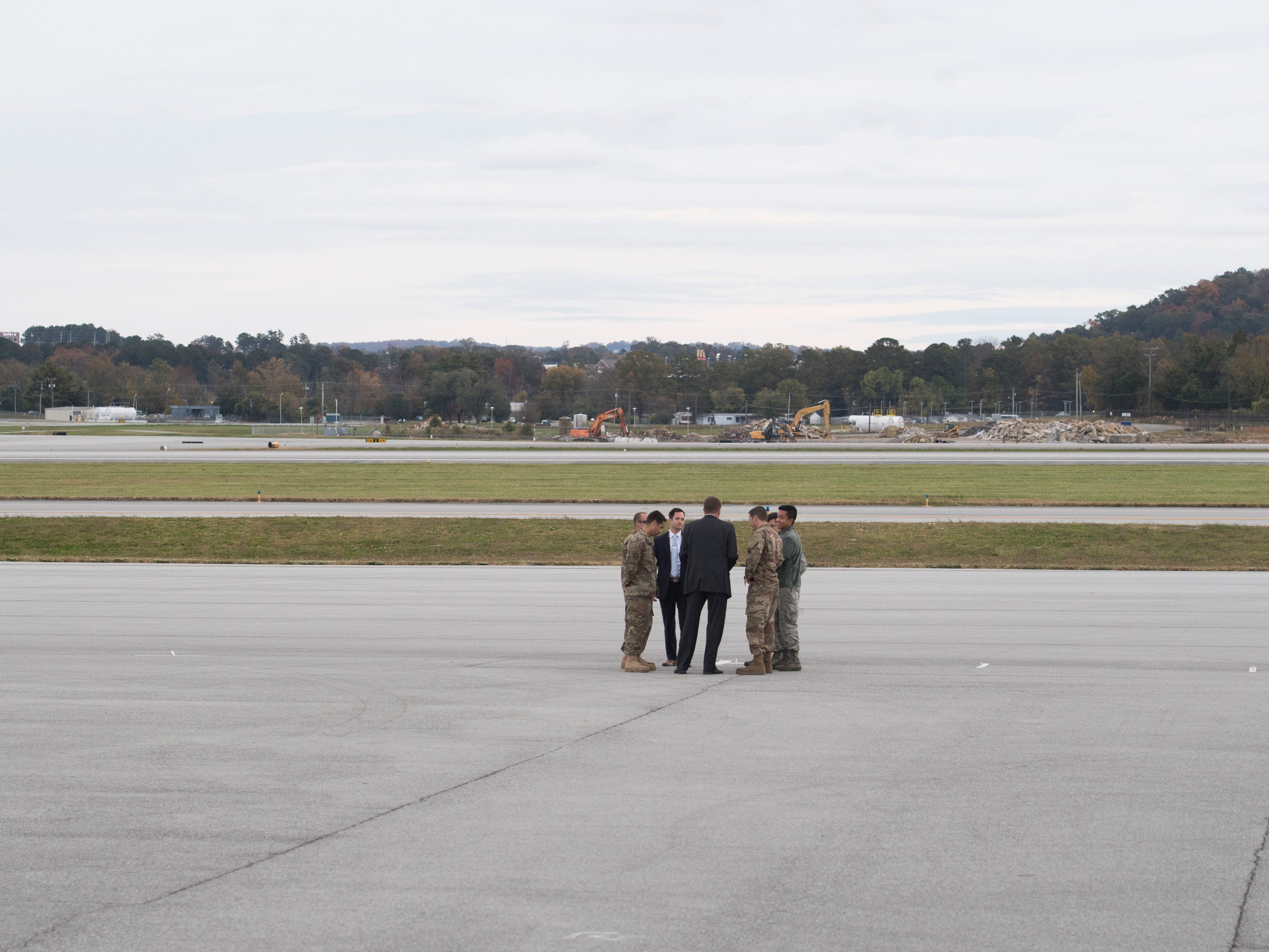 President Donald Trump's security detail on the tarmac at  the Wilson Air Center at the Chattanooga Metropolitan Airport on Sunday, November 4, 2018.