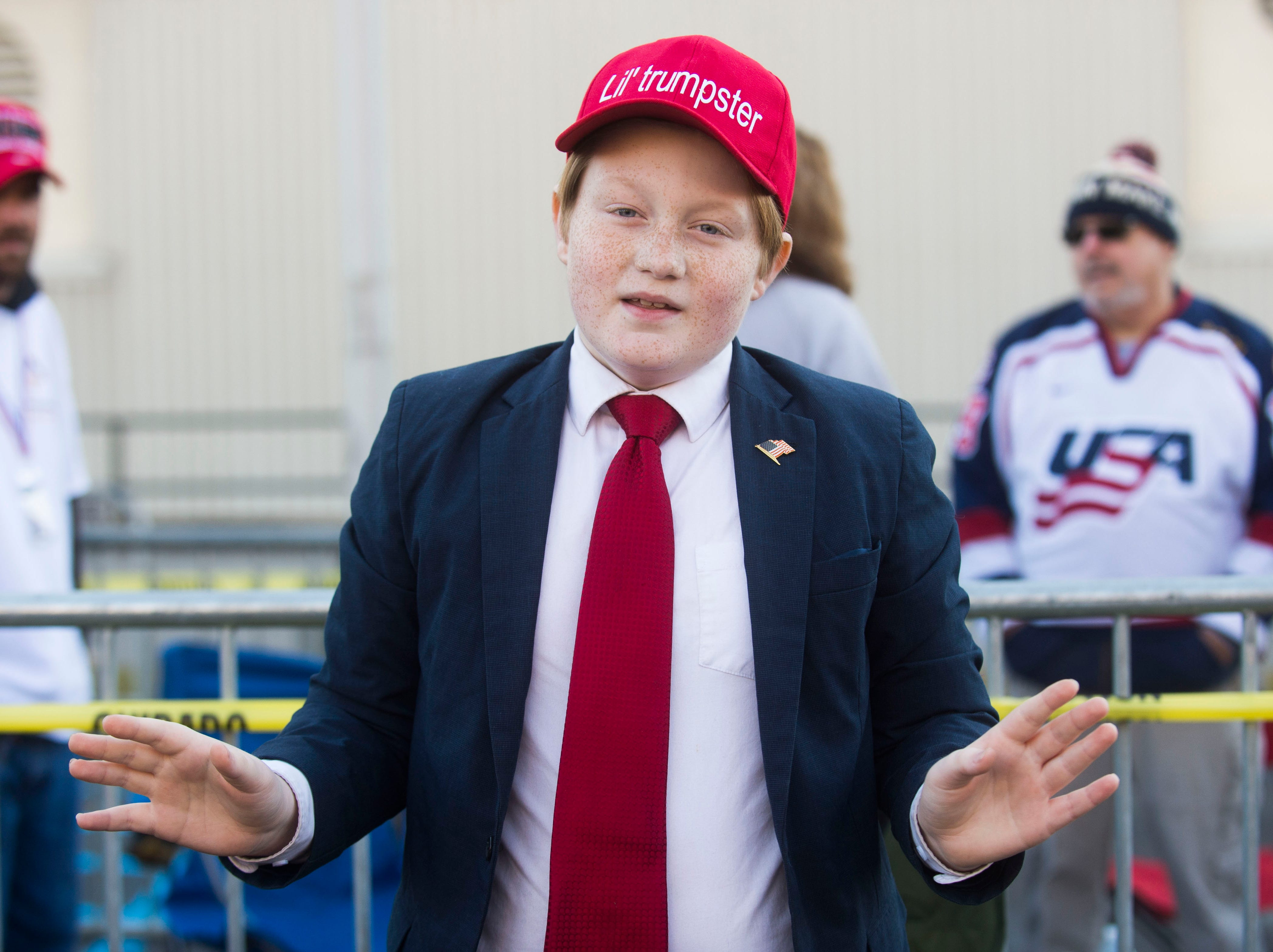 Garrett Bourg, 10, or Rome, Ga. poses like President Trump before a Donald Trump rally in support of U.S. Rep. Marsha Blackburn for the U.S. Senate at McKenzie Arena in Chattanooga, Sunday, Nov. 4, 2018.