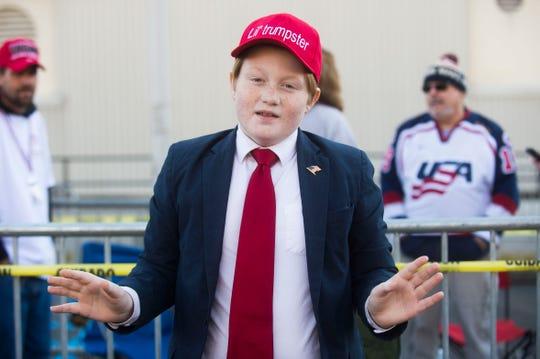 Garrett Bourg, 10, or Rome, Ga. poses like President Trump before a Donald Trump rally in support of U.S. Rep. Marsha Blackburn for the U.S. Senate at McKenzie Arena in Chattanooga, Sunday, Nov. 4, 2018.
