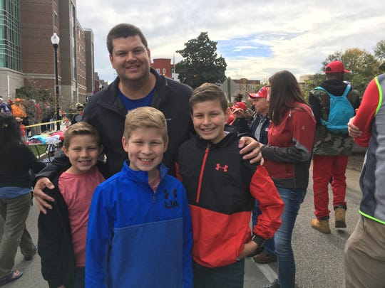 Randy Evans, from Cleveland, Tenn., and his three children await entry into McKenzie Arena for a rally headlined by President Donald Trump in support of Rep. Marsha Blackburn's candidacy for U.S. Senate, on Nov. 4, 2018 in Chattanooga.