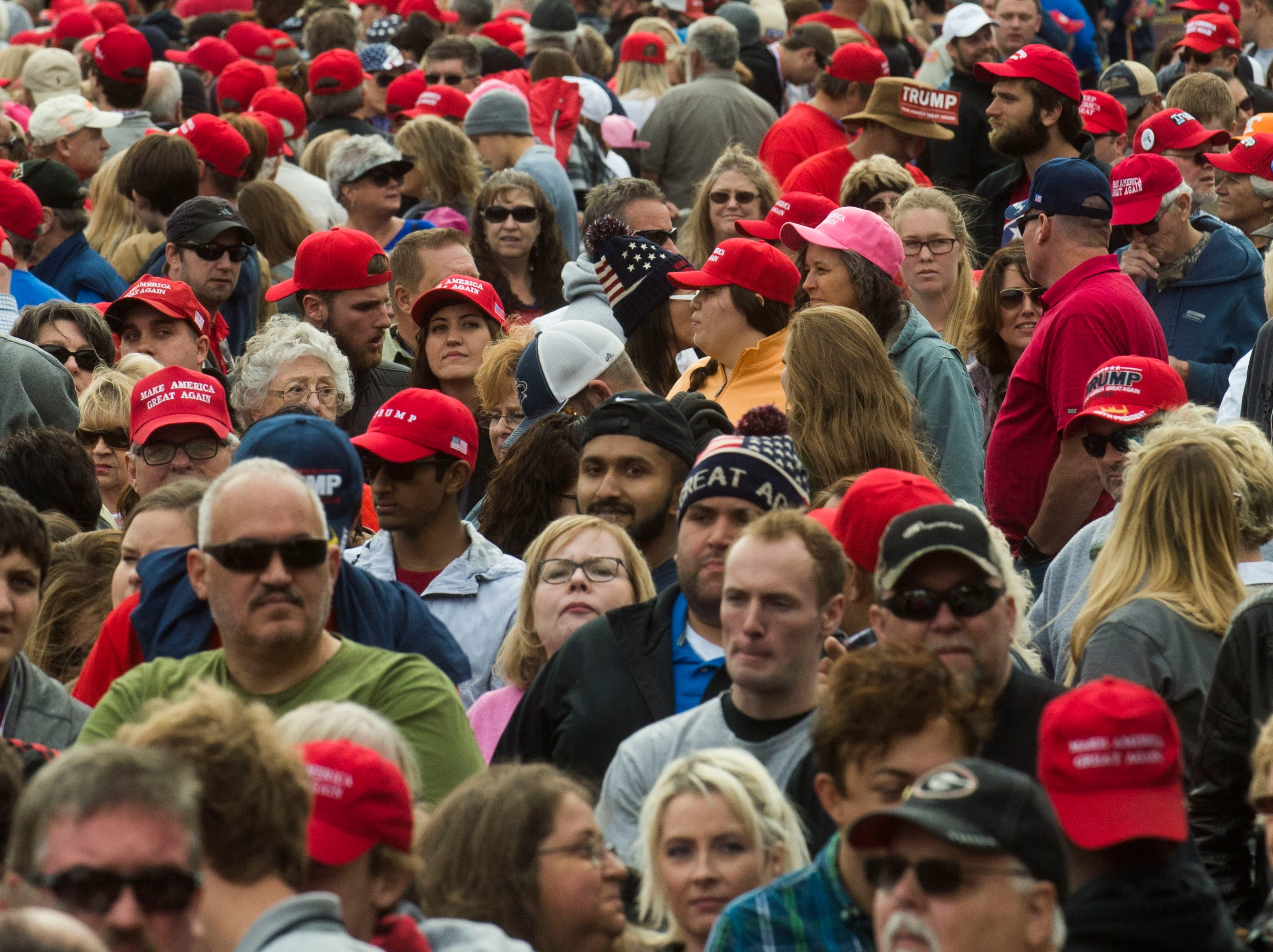 Trump supporters stand in line before a Donald Trump rally in support of U.S. Rep. Marsha Blackburn for the U.S. Senate at McKenzie Arena in Chattanooga, Sunday, Nov. 4, 2018.