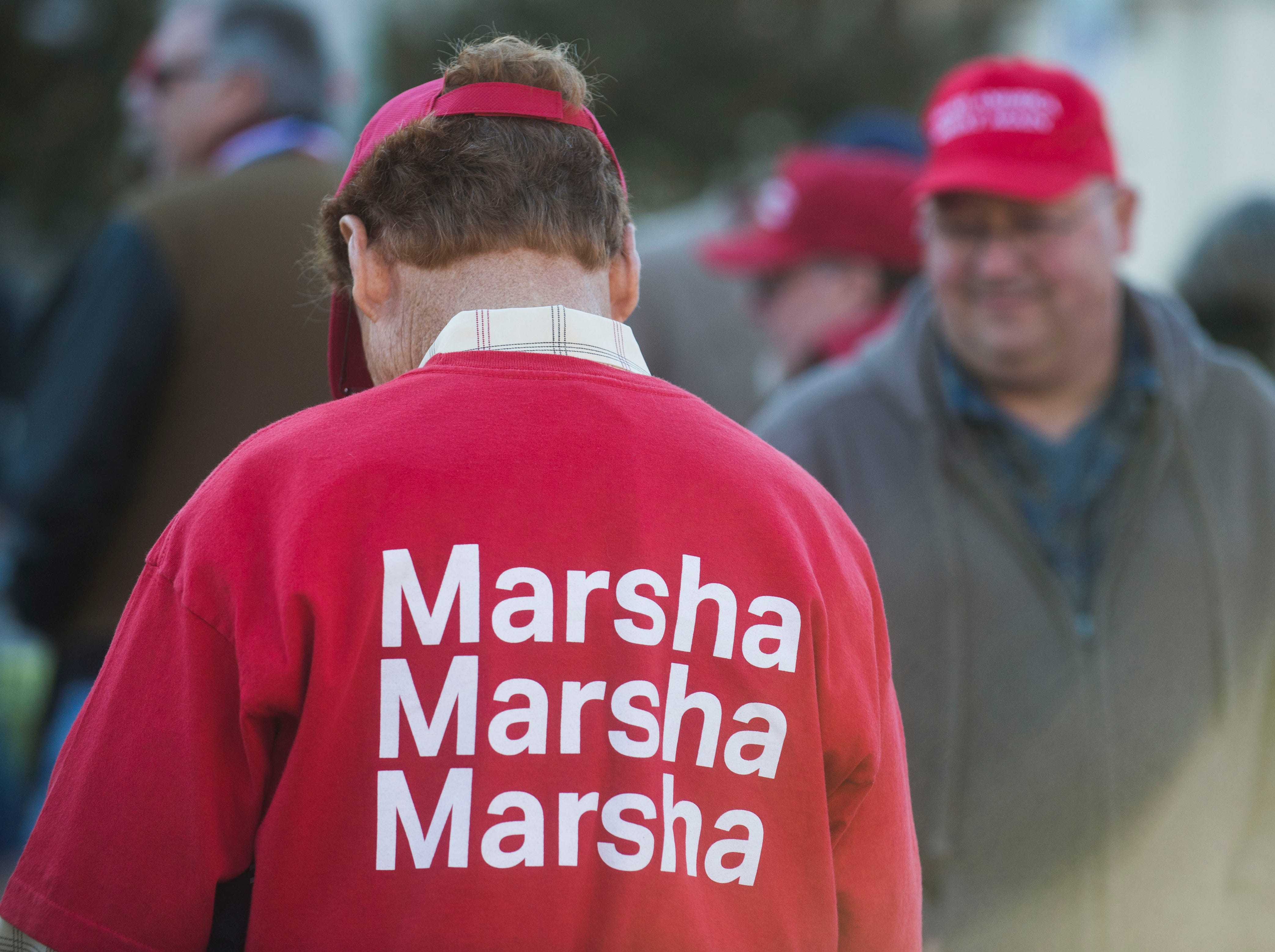 At left Terry Whitt of Ardmore, Tenn. wears a Marsha Blackburn shirt before a Donald Trump rally in support of U.S. Rep. Marsha Blackburn for the U.S. Senate at McKenzie Arena in Chattanooga, Sunday, Nov. 4, 2018.