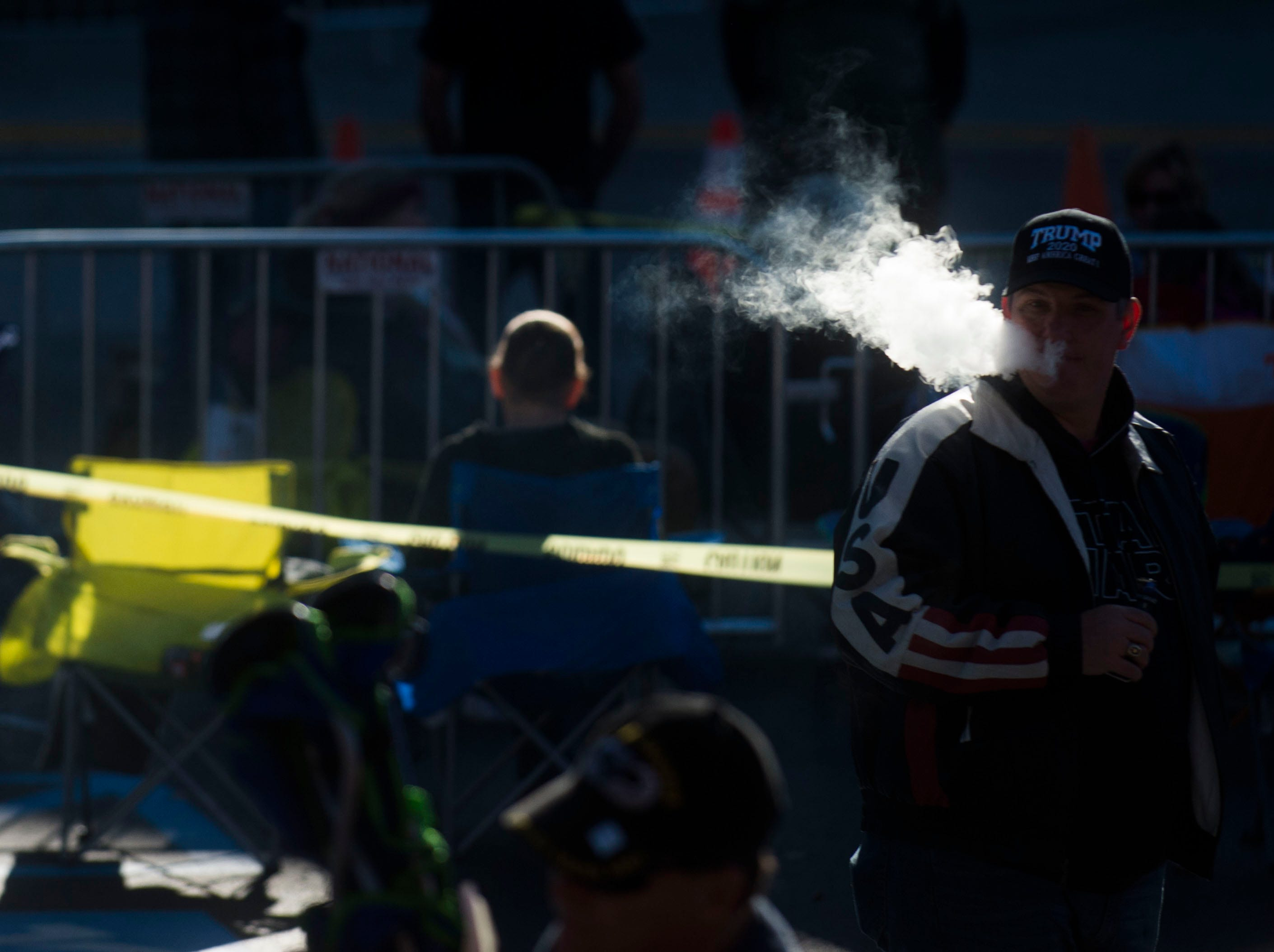 A trump supporter smokes while in line before a Donald Trump rally in support of U.S. Rep. Marsha Blackburn for the U.S. Senate at McKenzie Arena in Chattanooga, Sunday, Nov. 4, 2018.