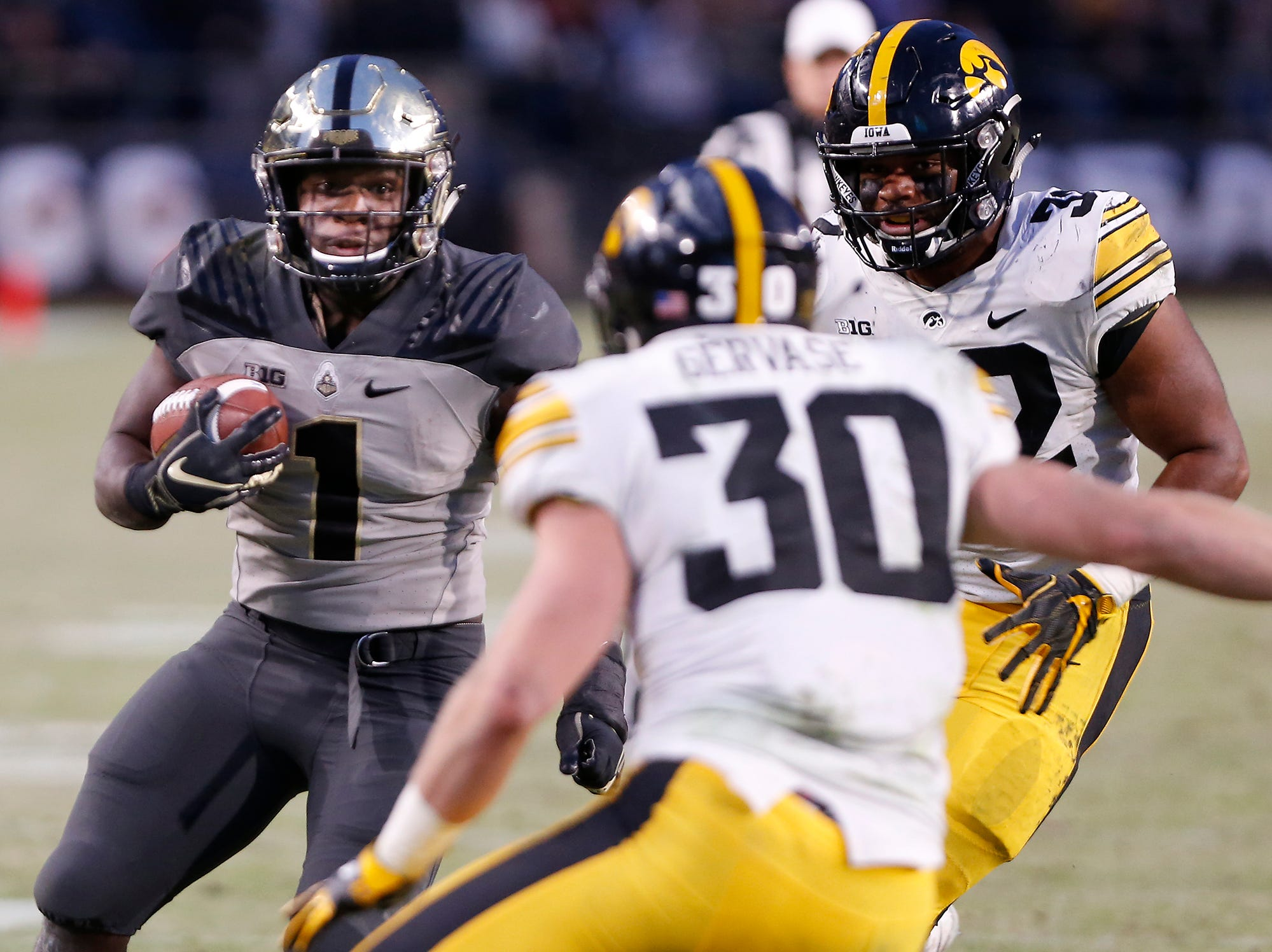 D. J. Knox with a carry for Purdue late in the fourth quarter against Iowa Saturday, November 3, 2018, at Ross-Ade Stadium. Purdue defeated Iowa 38-36.