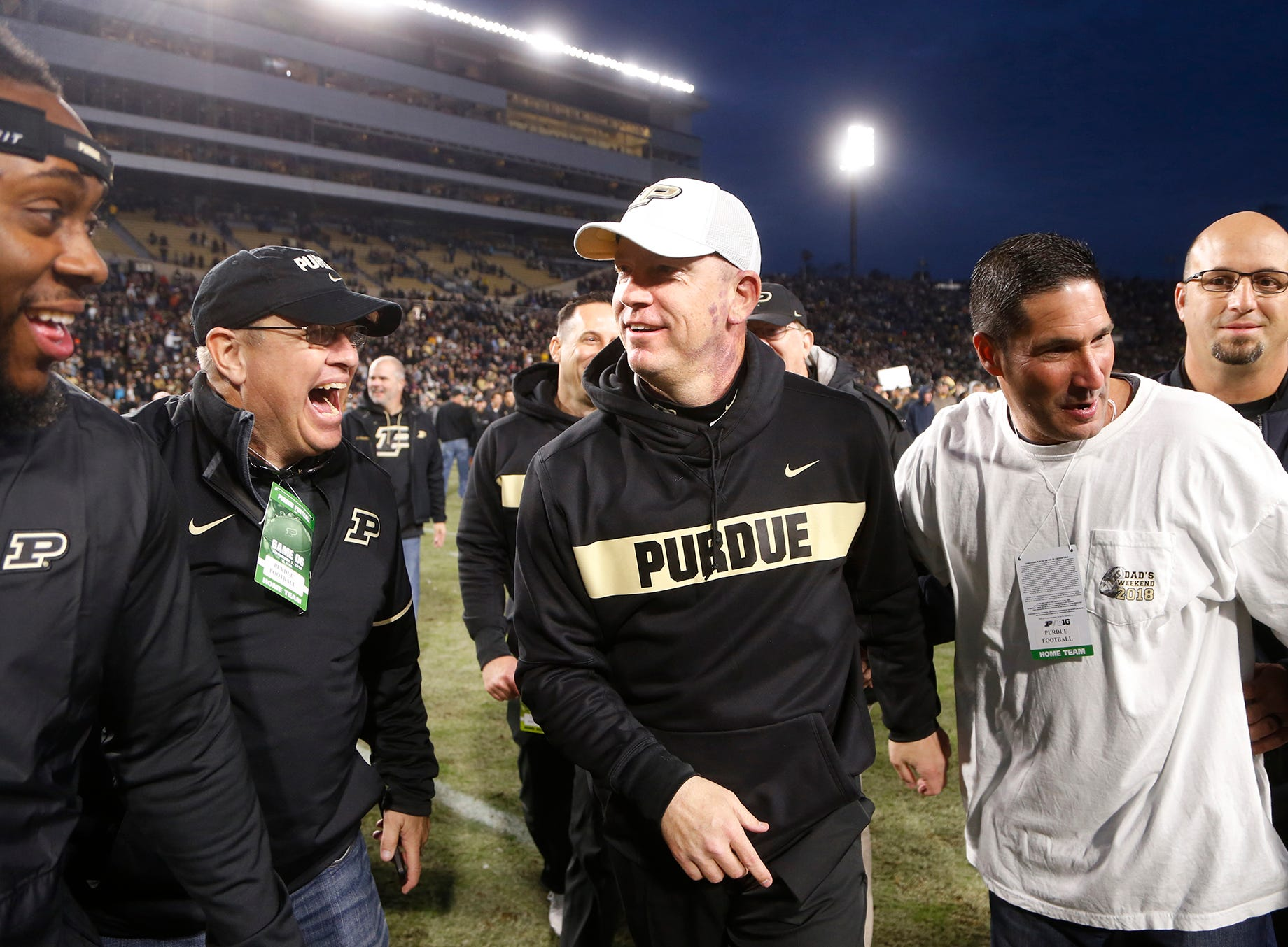 Purdue head coach Jeff Brohm is congratulated by fans after the Boilermakers defeated Iowa 38-36 Saturday, November 3, 2018, at Ross-Ade Stadium.