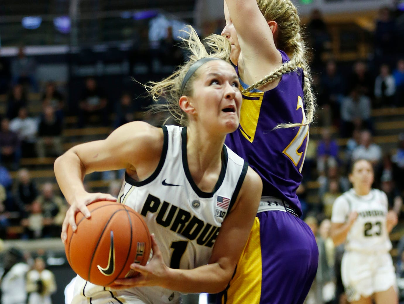 Karissa McLaughlin of Purdue with a drive to the basket around Jodi Johnson of Ashland Sunday, November 4, 2018, at Mackey Arena. Purdue defeated Ashland 85-69.
