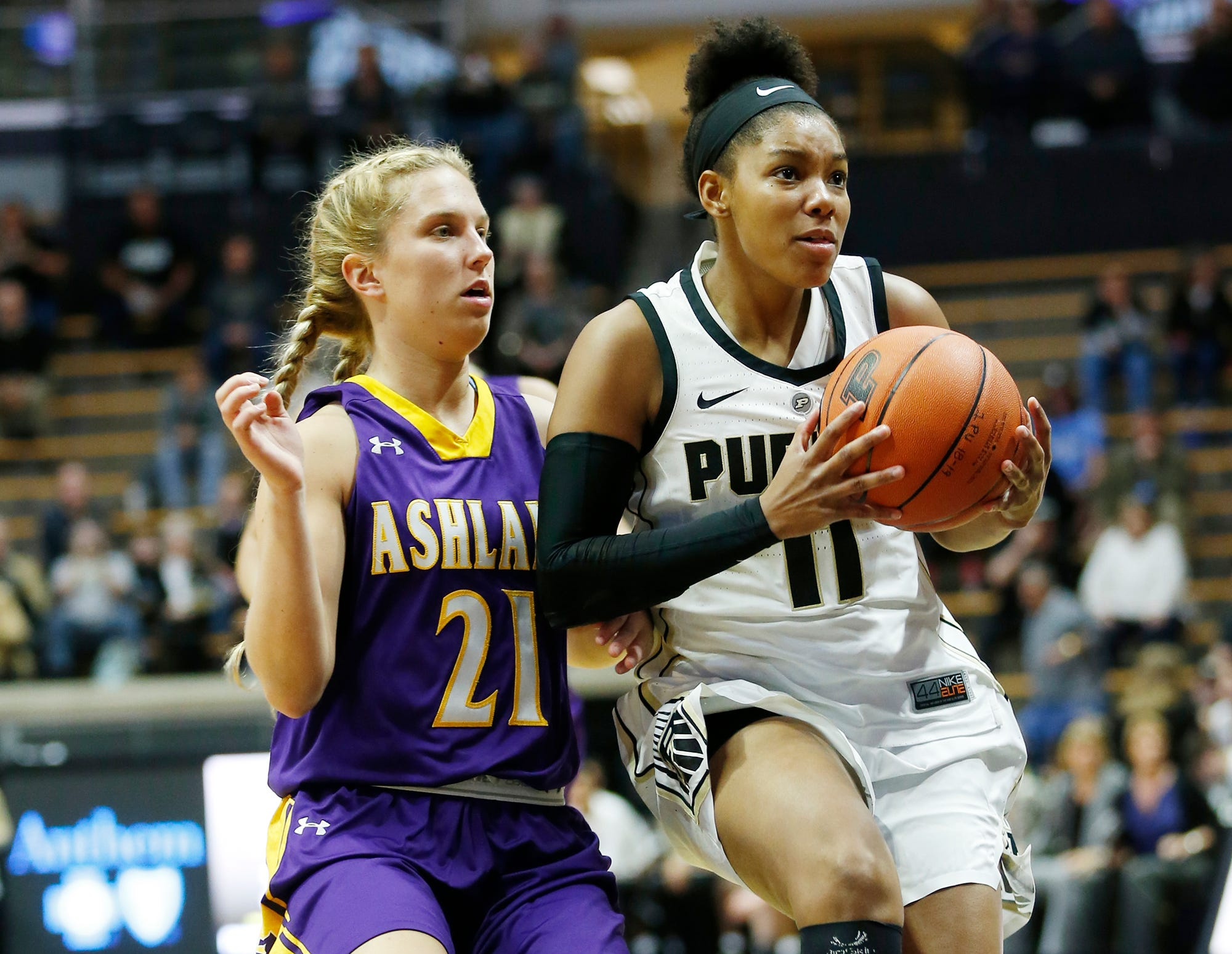 Purdue's Dominique Oden gets a step on Ashland's Jodi Johnson on Sunday in Mackey Arena.