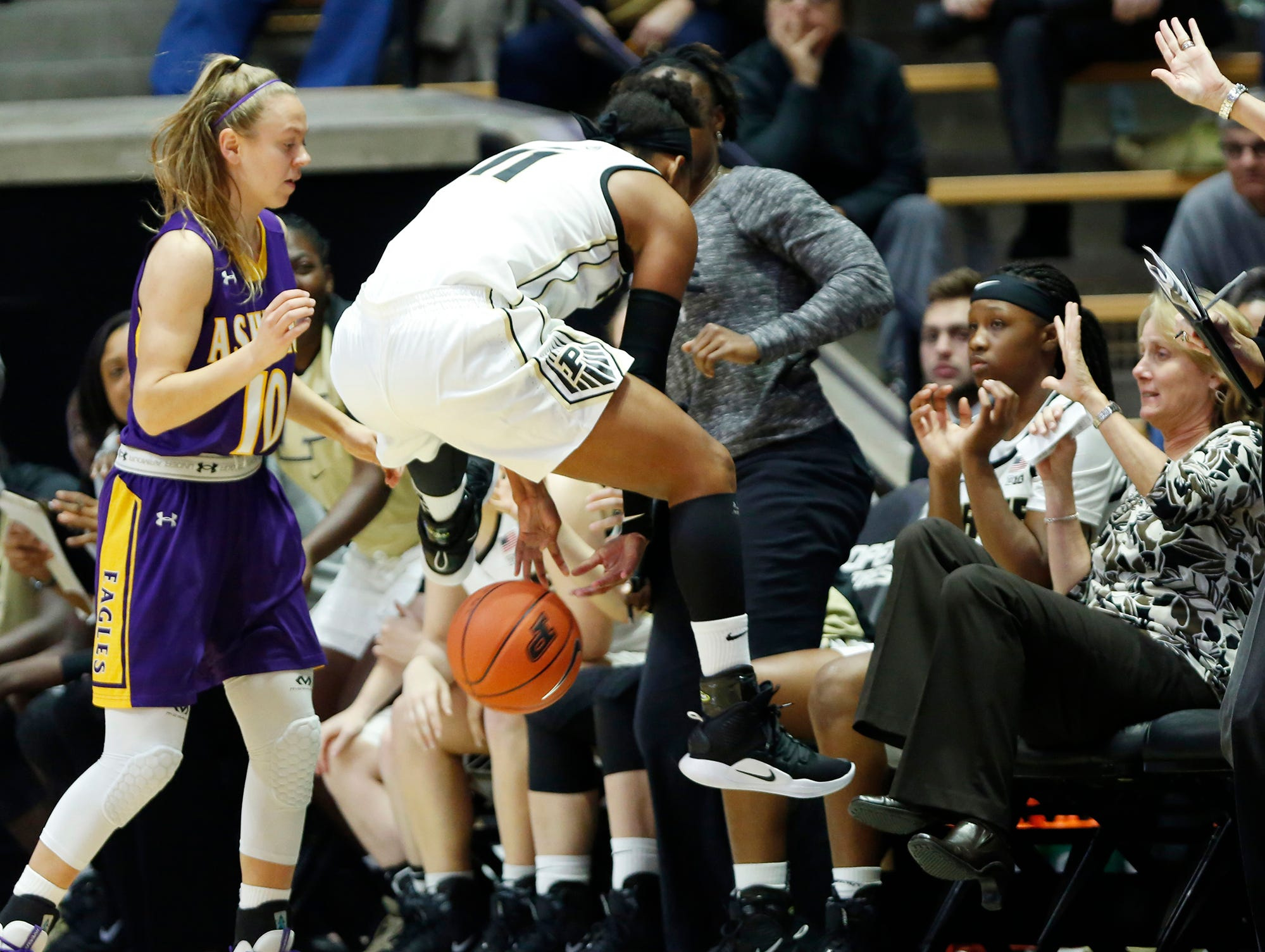 Dominique Oden throws a pass backwards between her legs before the ball goes out of bounds against Ashland Sunday, November 4, 2018, at Mackey Arena. Purdue defeated Ashland 85-69.
