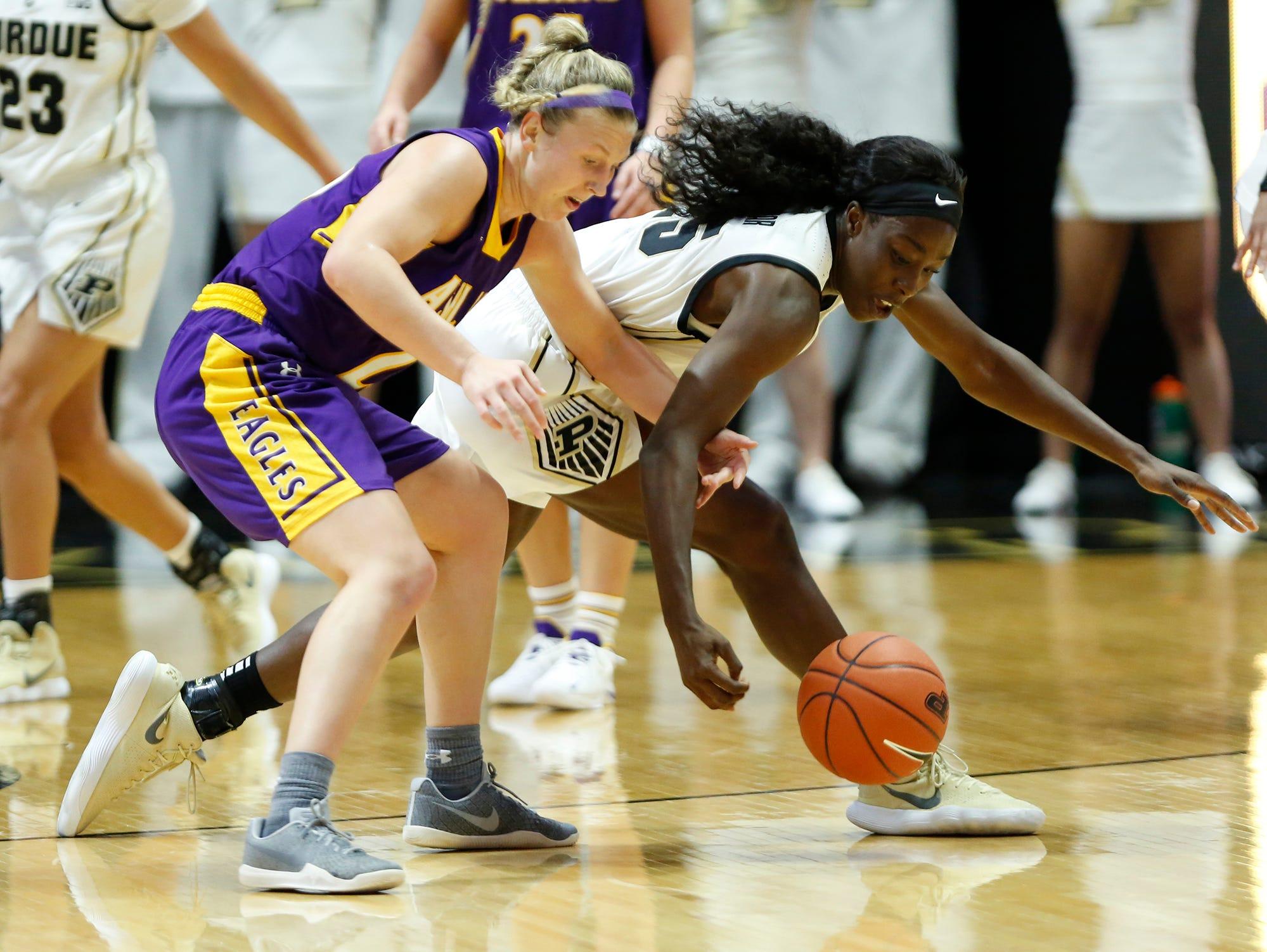 Tamara Farquhar of Purdue tries to steal the ball from Hallie Heidemann of Ashland Sunday, November 4, 2018, at Mackey Arena. Purdue defeated Ashland 85-69.