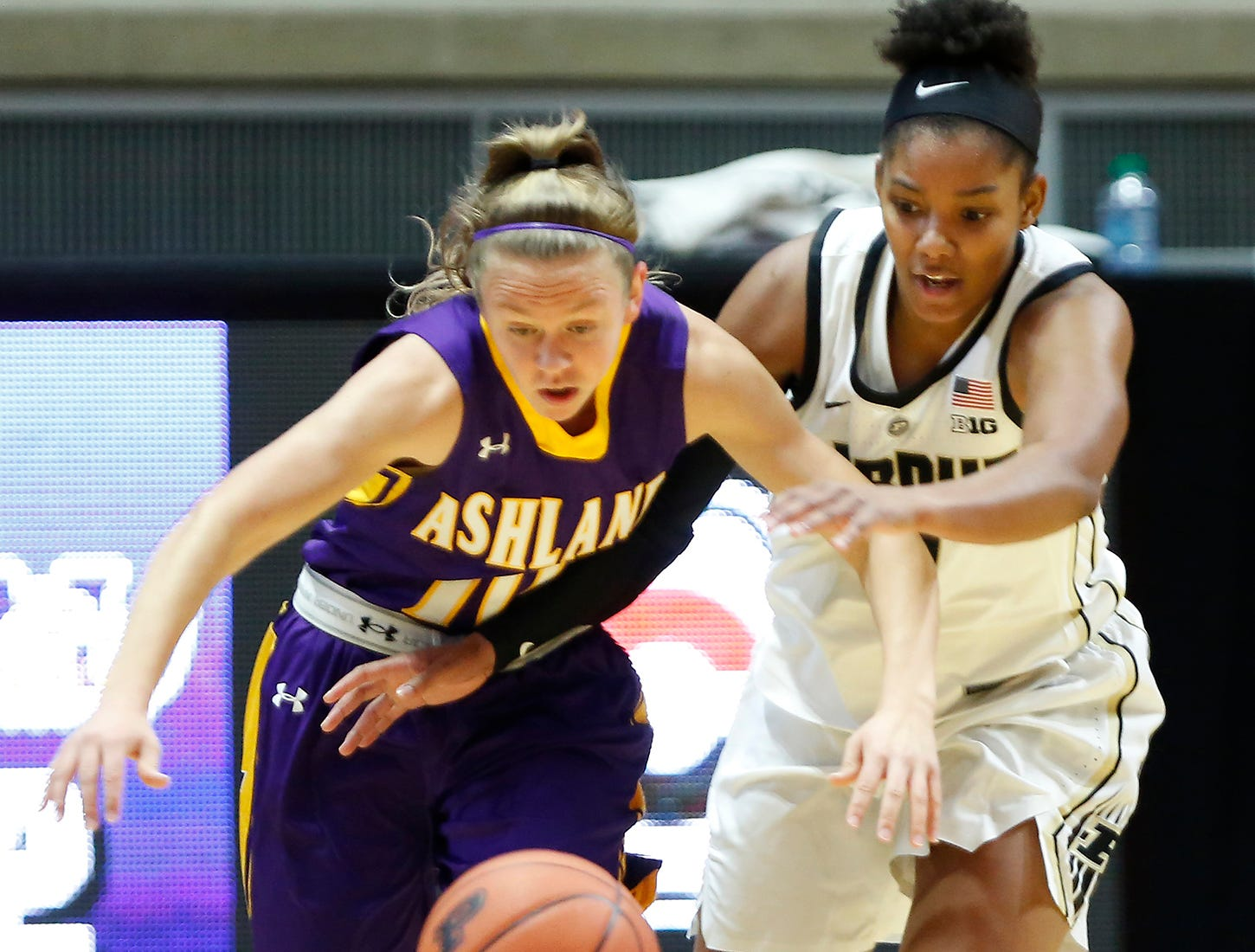 Dominique Oden of Purdue and Hallie Heidemann of Ashland chase a loose ball Sunday, November 4, 2018, at Mackey Arena. Purdue defeated Ashland 85-69.