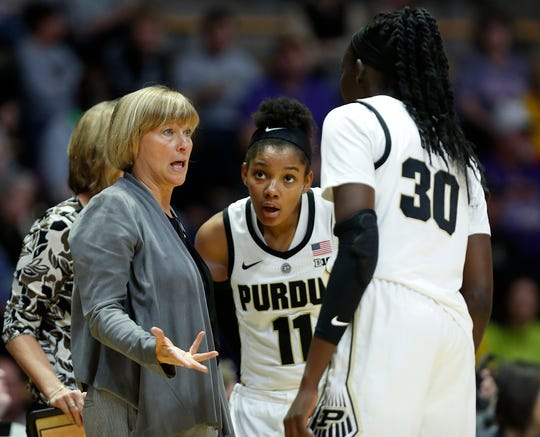 Purdue head coach Sharon Versyp talks with Nyagoa Gony and other players during a timeout against Ashland Sunday, November 4, 2018, at Mackey Arena. Purdue defeated Ashland 85-69.