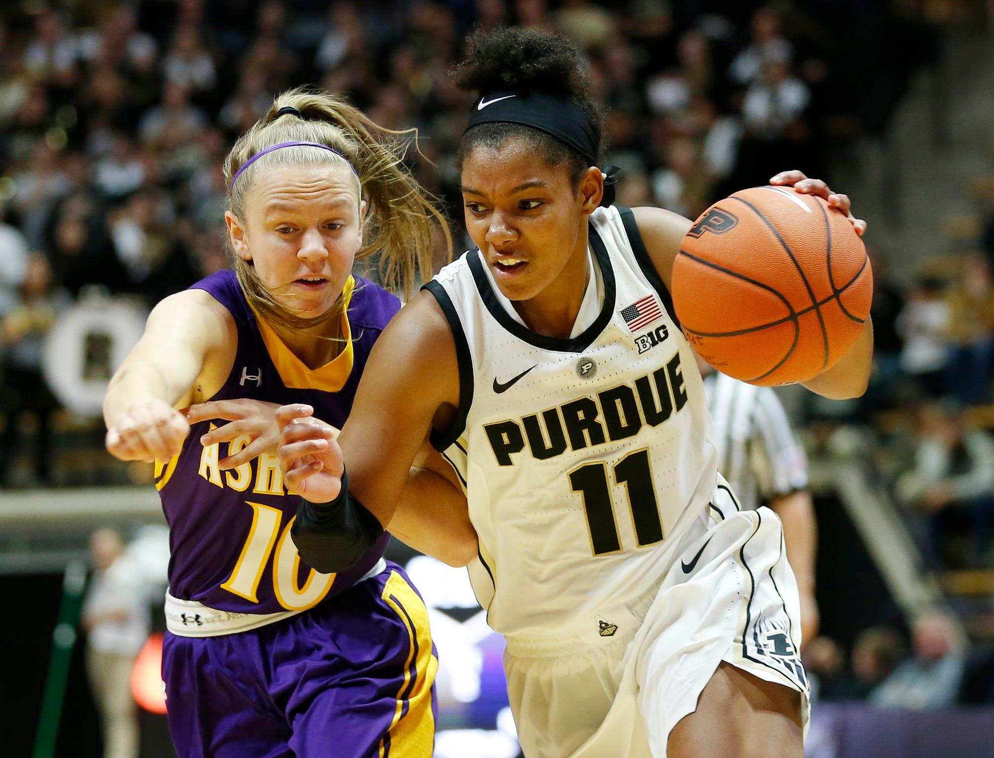 Dominique Oden of Purdue with a drive to the basket against Hallie Heidemann of Ashland Sunday, November 4, 2018, at Mackey Arena. Purdue defeated Ashland 85-69.