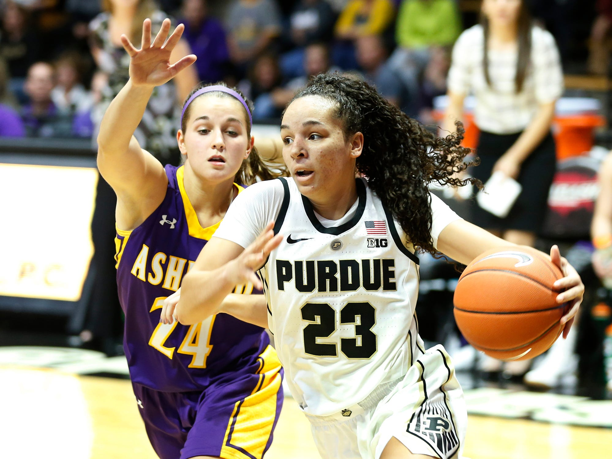 Kayana Traylor of Purdue with a drive past Brooke Smith of Ashland Sunday, November 4, 2018, at Mackey Arena.