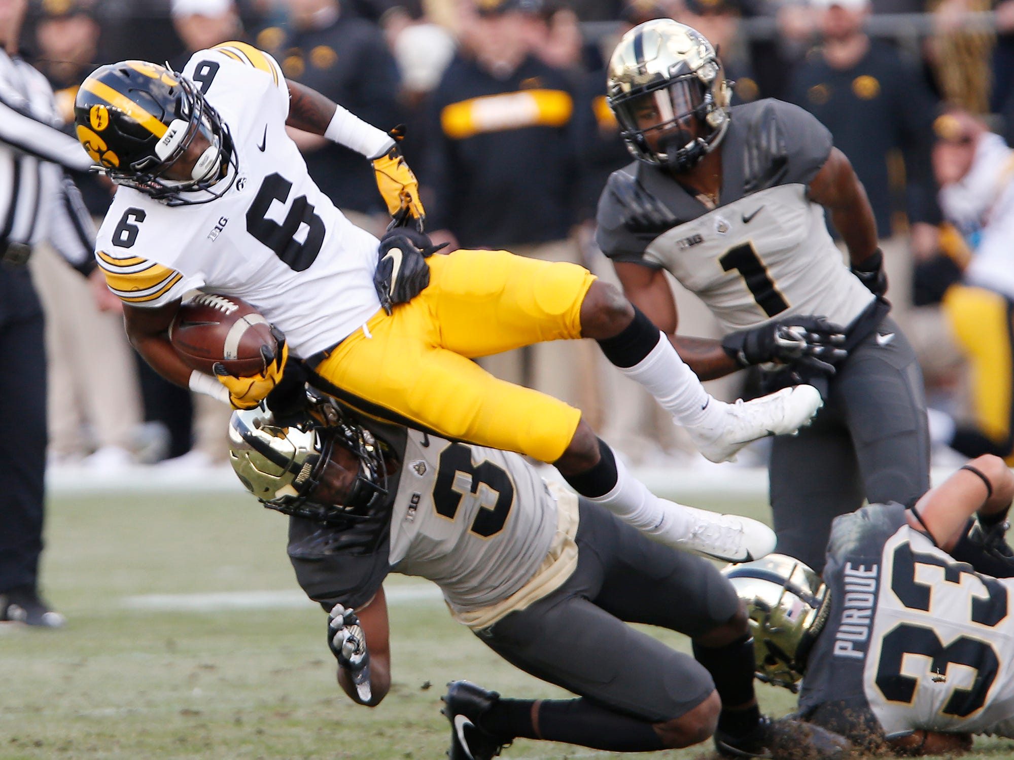 Ihmir Smith-Marsette of Iowa is brought down by Kamal Hardy of Purdue on a kickoff return Saturday, November 3, 2018, at Ross-Ade Stadium. Purdue defeated Iowa 38-36.