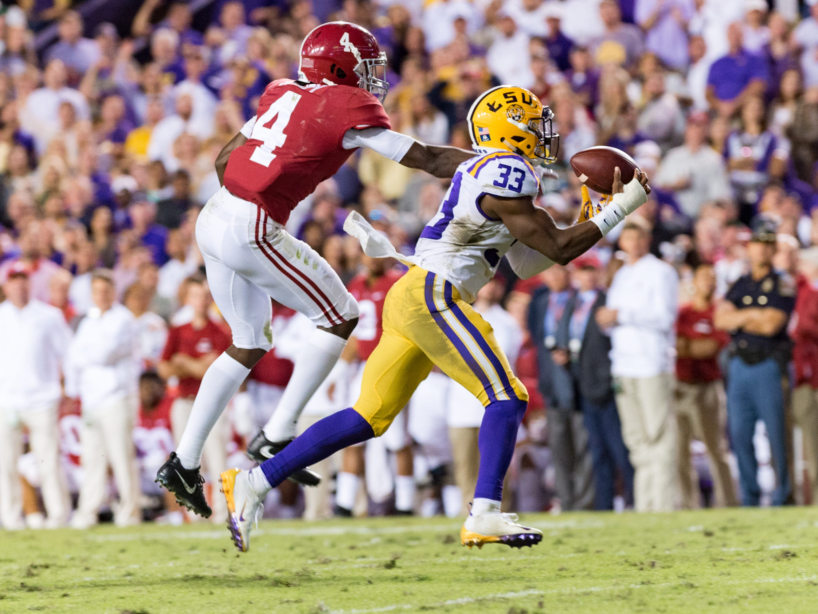 Tigers safety Todd Harris Jr makes an interception as the No. 4-ranked LSU Tigers take on the No. 1  Alabama Crimson Tide in Tiger Stadium Saturday, Nov. 3, 2018.