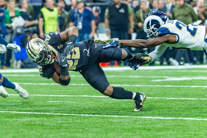 Saints runningback Mark Ingram II runs the ball and dives for extra yardage during the NFL football game between the New Orleans Saints and the Los Angeles Rams on Sunday, Nov. 4, 2018.