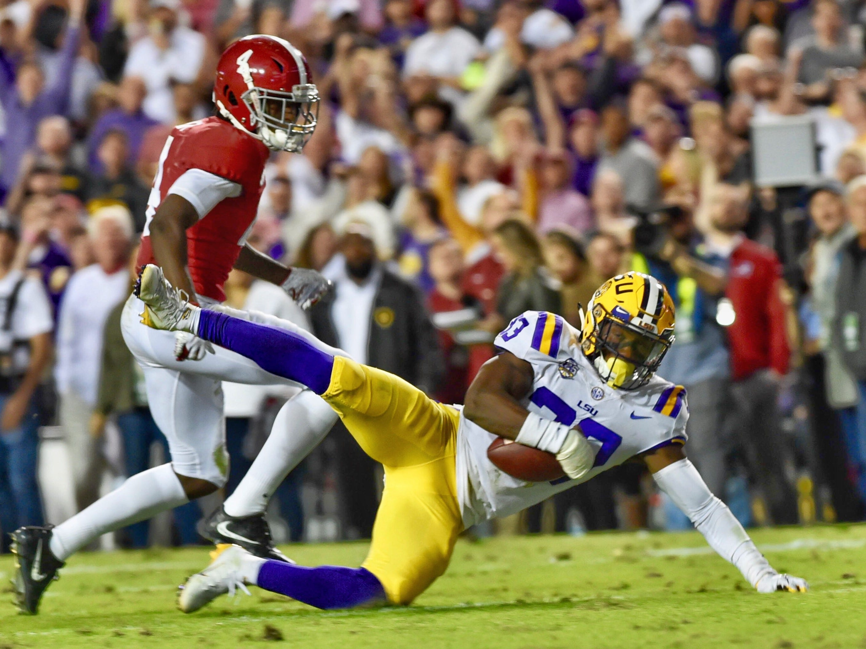 LSU safety Todd Harris Jr. intercepts an Alabama pass as the Tigers take on the Crimson Tide at Tiger Stadium Saturday Nov. 3, 2018.