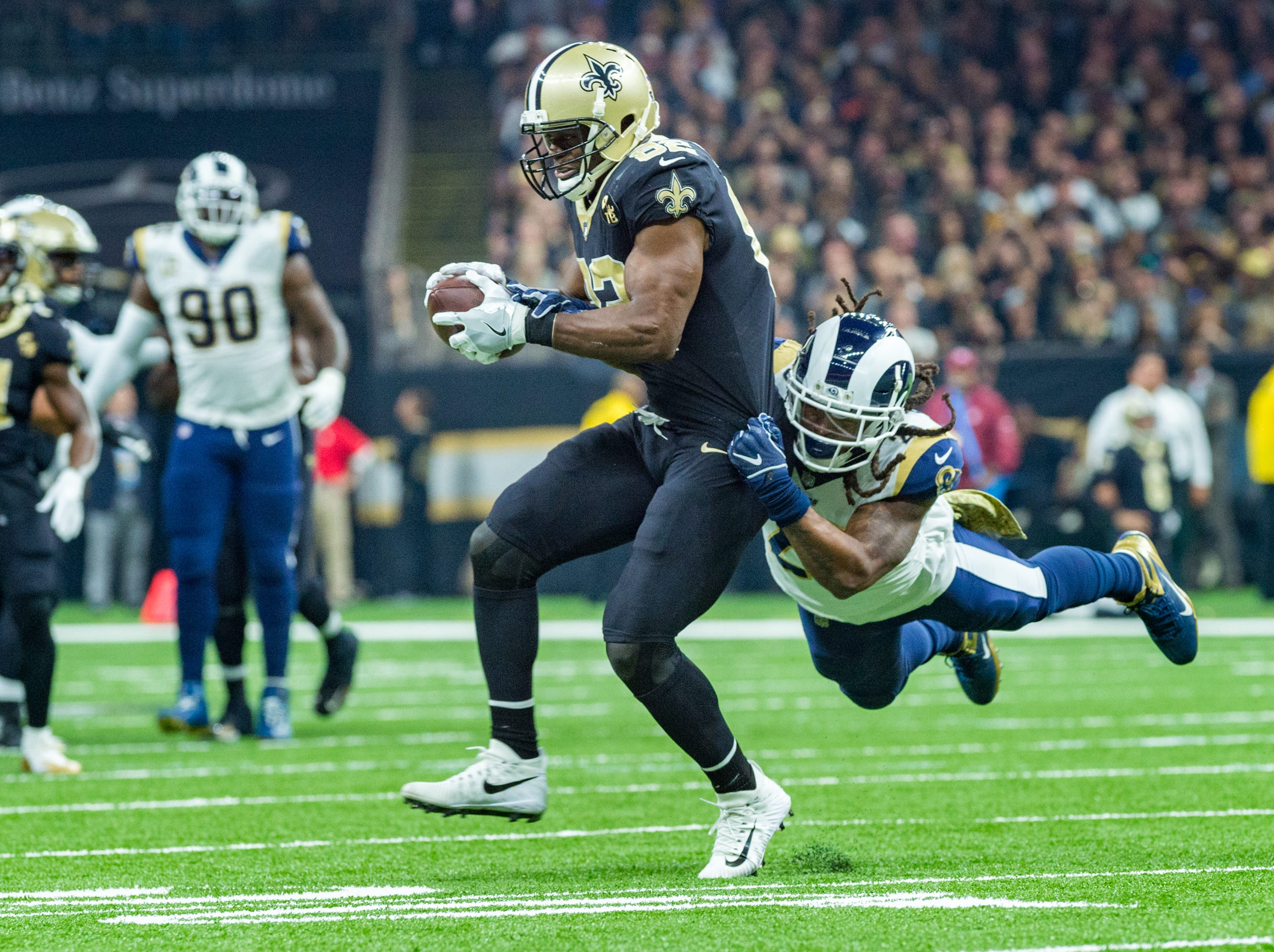 Saints runningback Mark Ingram II makes a catch and runs the ball during the NFL football game between the New Orleans Saints and the Los Angeles Rams on Sunday, Nov. 4, 2018.