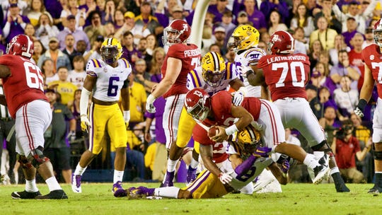 The LSU defense sacks Alabama quarterback Tua Tagovailoa as the Tigers take on the Crimson Tide at Tiger Stadium Saturday Nov. 3, 2018.