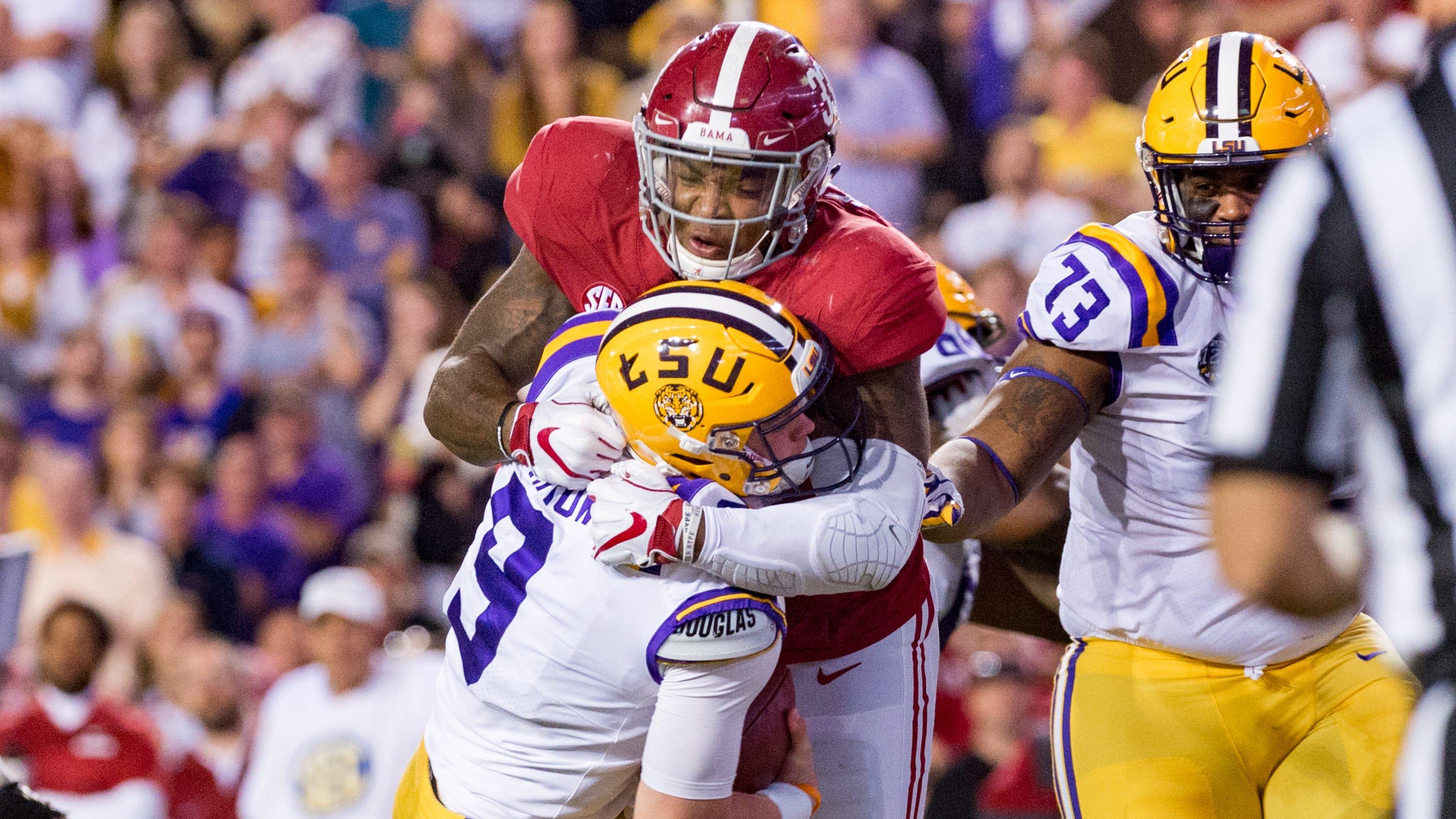 Tigers quarterback Joe Burrow is sacked by Alabama linebacker Anfernee Jennings as The No. 4-ranked LSU Tigers take on the No. 1 Alabama Crimson Tide in Tiger Stadium Saturday, Nov. 3, 2018.