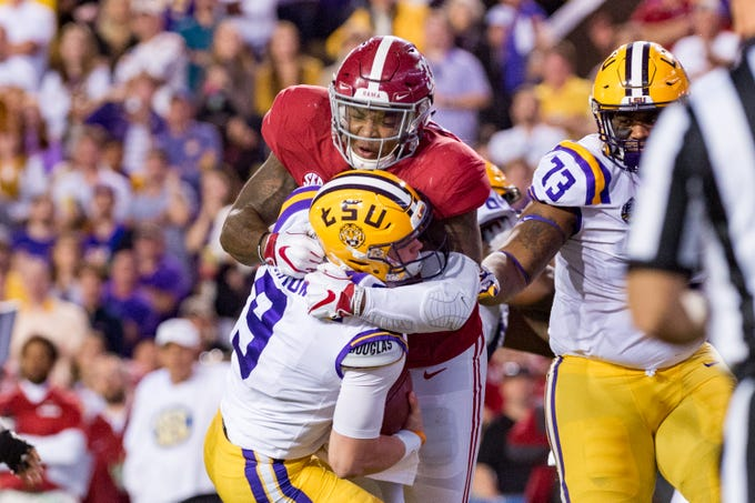 Tigers quarterback Joe Burrow is sacked by Alabama linebacker Anfernee Jennings as The No. 4-ranked LSU Tigers take on the No. 1 Alabama Crimson Tide in Tiger Stadium Saturday, Nov. 3, 2018.