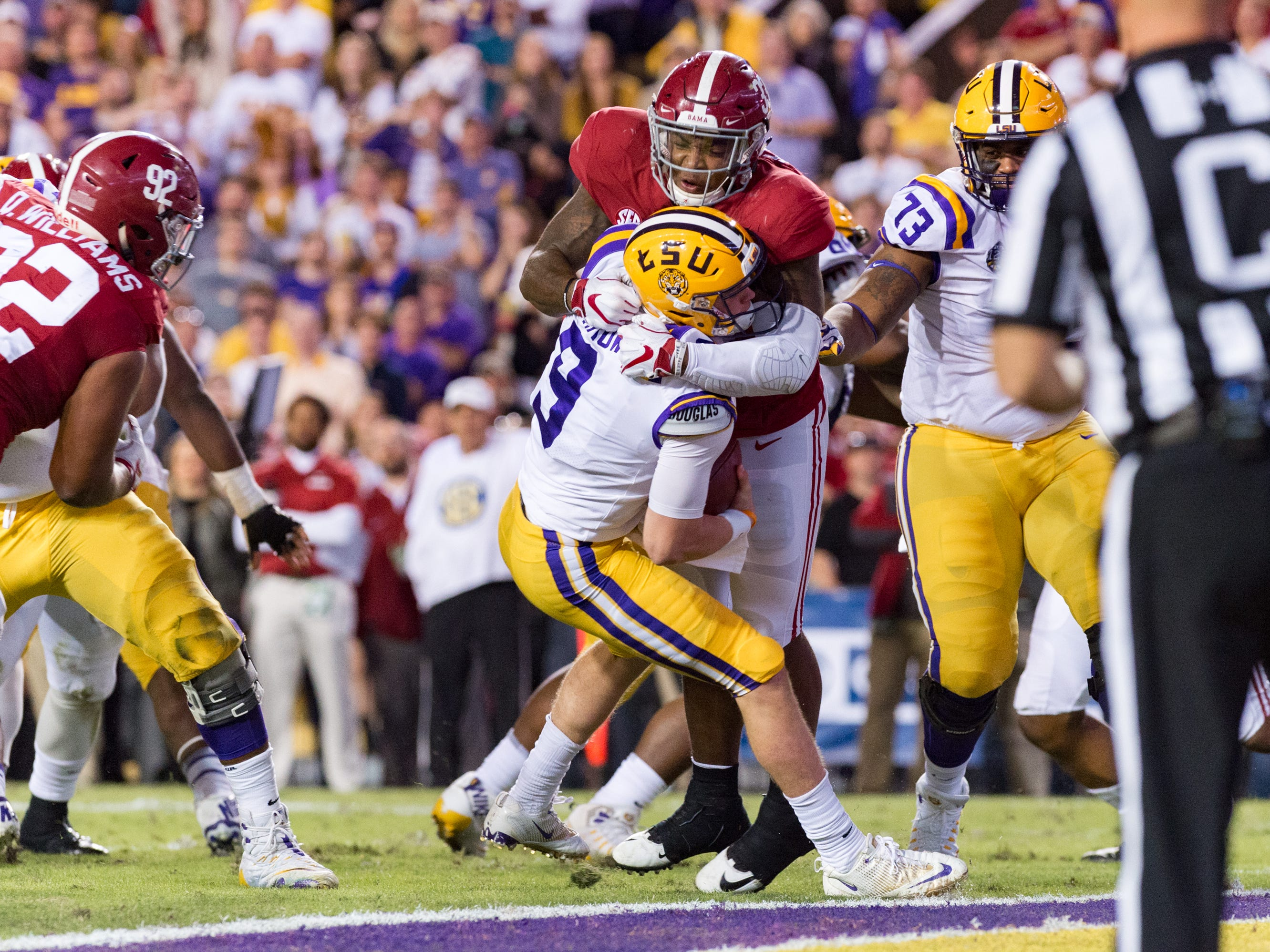 Tigers quarterback Joe Burrow is sacked by linebacker Anfernee Jennings as the No. 4-ranked LSU Tigers take on the No. 1  Alabama Crimson Tide in Tiger Stadium Saturday, Nov. 3, 2018.